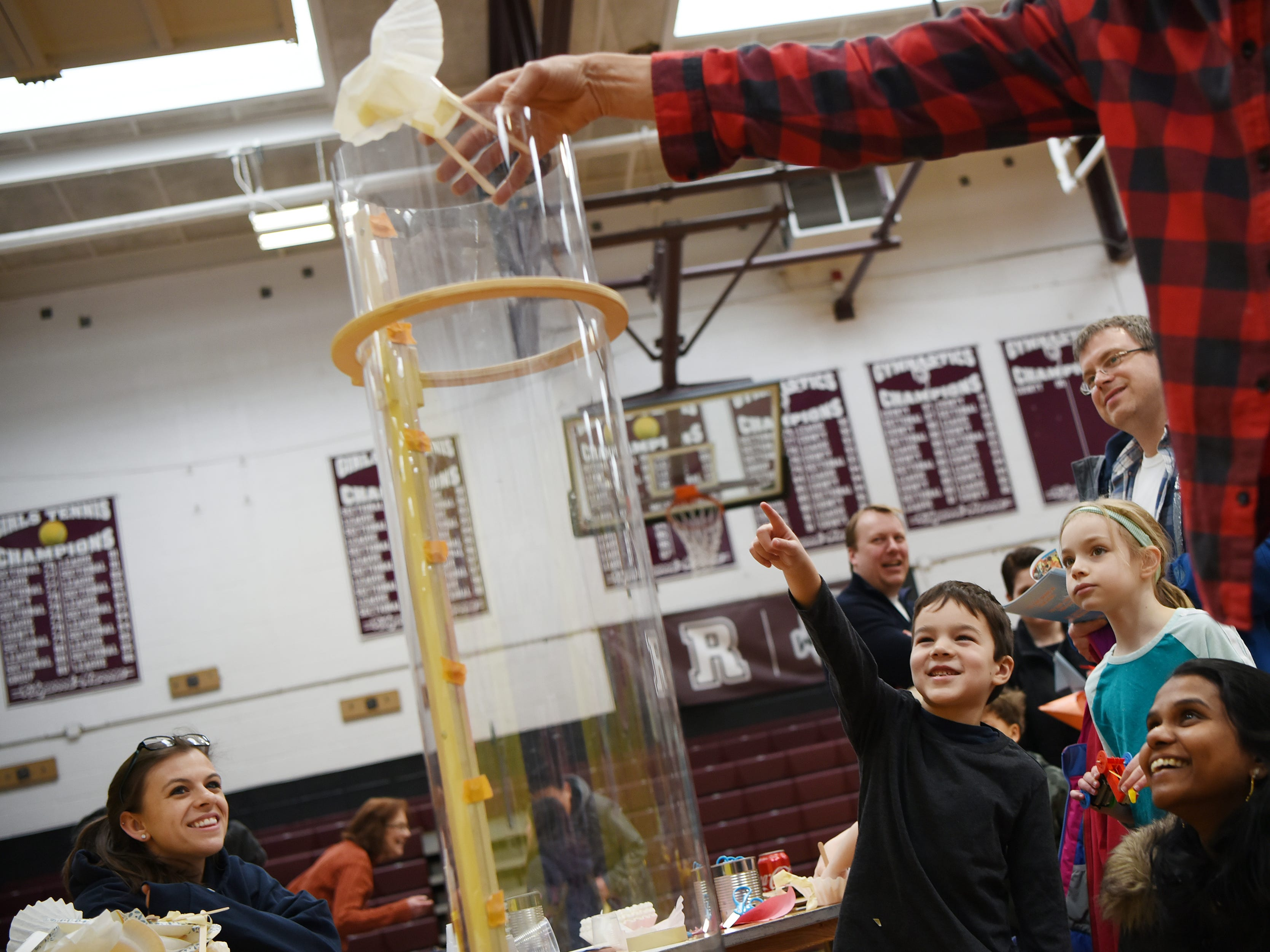 Charlotte Lucey (left) looks on while Bryce Wallace, 6, reacts to the flying machine he made. This is one of many activities during Super Science Saturday held at Ridgewood High School in Ridgewood on Saturday March 2, 2019.