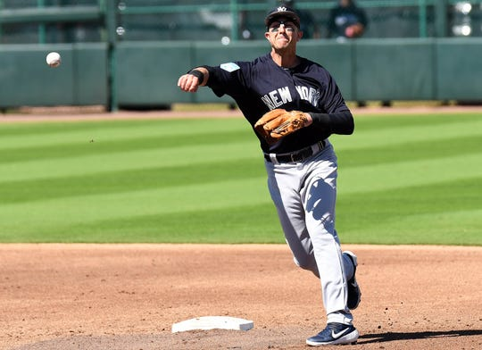 Mar 2, 2019; Bradenton, FL, USA; New York Yankees infielder Troy Tulowitzki (12) makes a throw to first base in the third inning of the spring training game against the Pittsburgh Pirates   at LECOM Park.