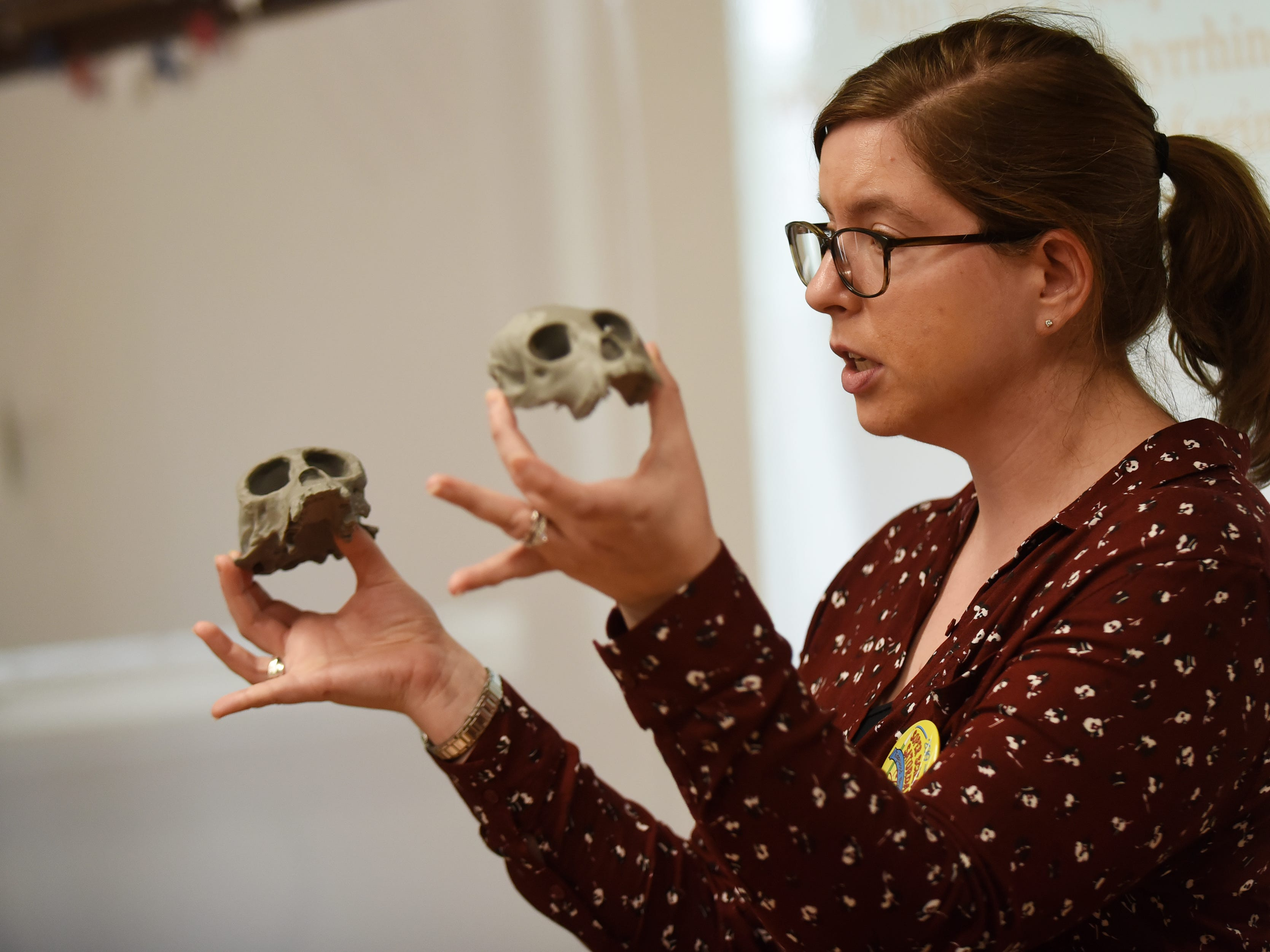 "Lauren B. Halenar-Price, PHD and former Ridgewood Student, holds up different primate skulls during a lecture ""Supermonkey of the Americas"". This is one of many activities during Super Science Saturday held at Ridgewood High School in Ridgewood on Saturday March 2, 2019."