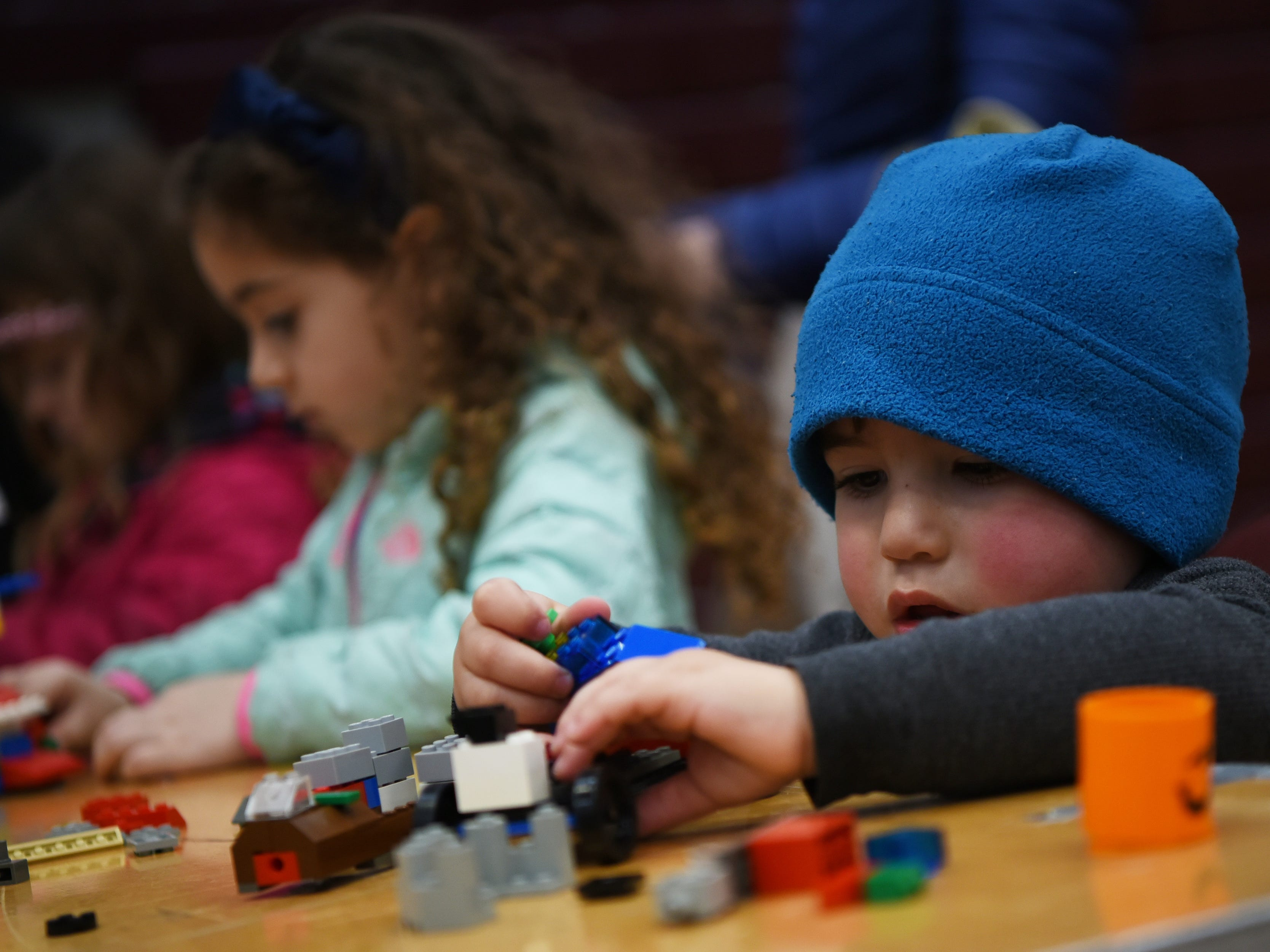 Genevieve Tavani, 4 and Luke Della Torre, 2 play with LEGO blocks. This is one of many activities during Super Science Saturday held at Ridgewood High School in Ridgewood on Saturday March 2, 2019.