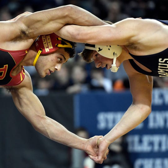 Jacob Cardenas of Bergen Catholic, left, wrestles Kyle Jacob of Paramus in the 195-pound final during the NJSIAA state wrestling tournament on Saturday, March 2, 2019, in Atlantic City.