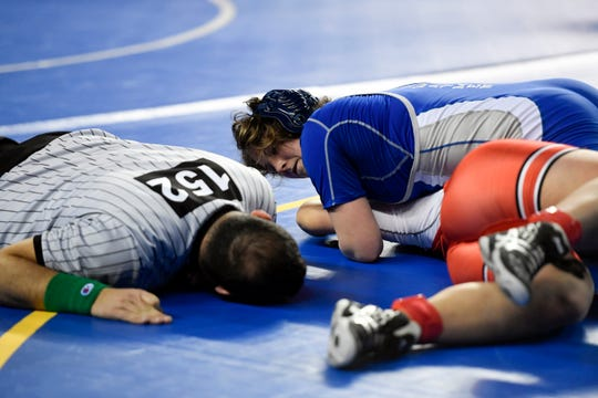 Erin Emery of Teaneck looks to the referee as she pins  Maria Taseva of Elmwood Park to win the 185-pound semifinal on Day 2 of the NJSIAA state wrestling tournament on Friday, March 1, 2019, in Atlantic City.