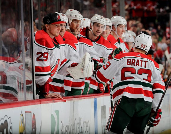 Jesper Bratt #63 of the New Jersey Devils is congratulated by teammates on the bench after he scored in the second period against the Philadelphia Flyers on March 01, 2019 at Prudential Center in Newark, New Jersey.