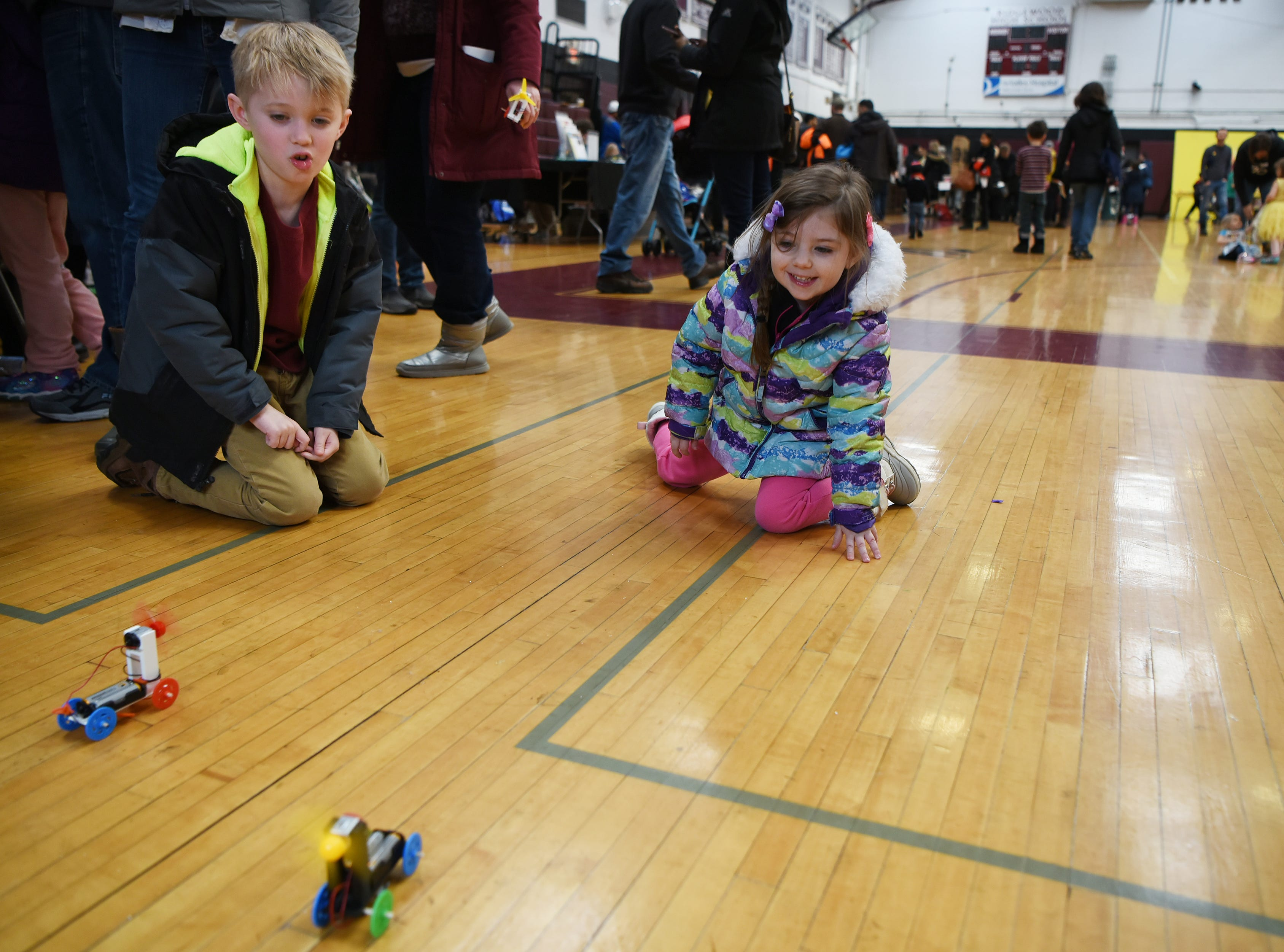 Tad Truhn, 8 and Chloe Truhn, 3 race the wind-powered electric cars they made at Super Science Saturday held at Ridgewood High School in Ridgewood on Saturday March 2, 2019.