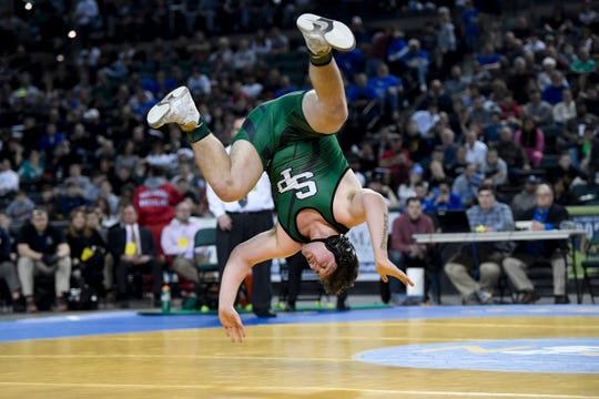 Zach DelVecchio of South Plainfield does a back flip after defeating Michael Filieri of Garfield (not pictured) for the 220-pound title during the NJSIAA state wrestling tournament on Saturday, March 2, 2019, in Atlantic City.