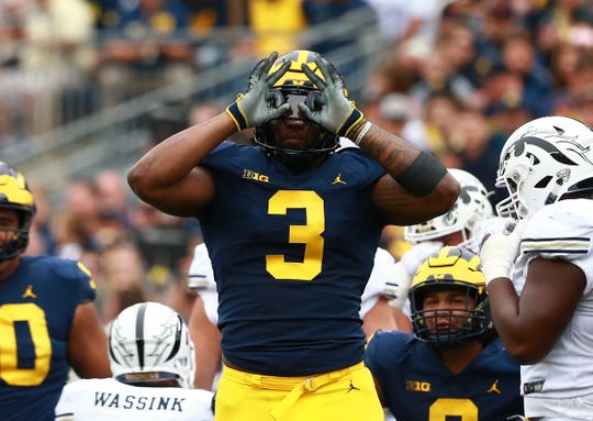 ANN ARBOR, MI - SEPTEMBER 08: Rashan Gary #3 of the Michigan Wolverines reacts to a sack against the Western Michigan Broncos at Michigan Stadium on September 8, 2018 in Ann Arbor, Michigan.