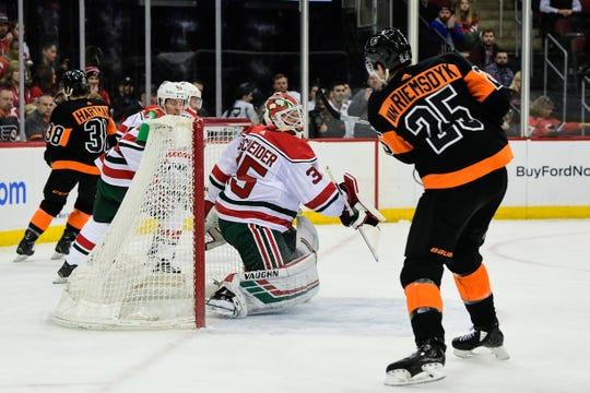 Mar 1, 2019; Newark, NJ, USA; Philadelphia Flyers left wing James van Riemsdyk (25) scores a goal past New Jersey Devils goalie Corey Schneider (35) in the first period at Prudential Center.