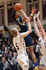 Hackensack at Ridgewood in a North 1, Group 4 boys basketball semifinal on Friday, March 1, 2019. H #0 Seth Brown drives to the basket.