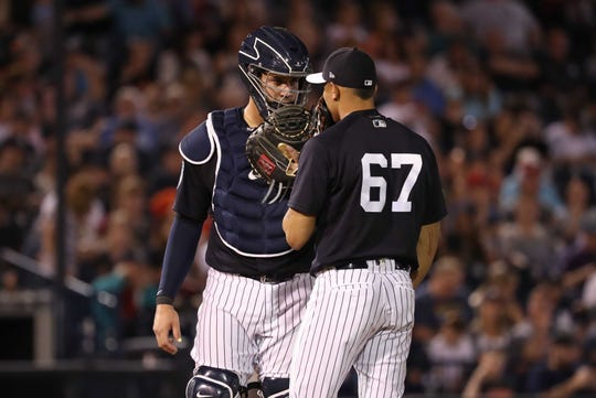 Mar 1, 2019; Tampa, FL, USA; New York Yankees catcher Gary Sanchez (24) and pitcher Jonathan Loaisiga (67) talk on the mound during the fourth inning against the Baltimore Orioles at George M. Steinbrenner Field.