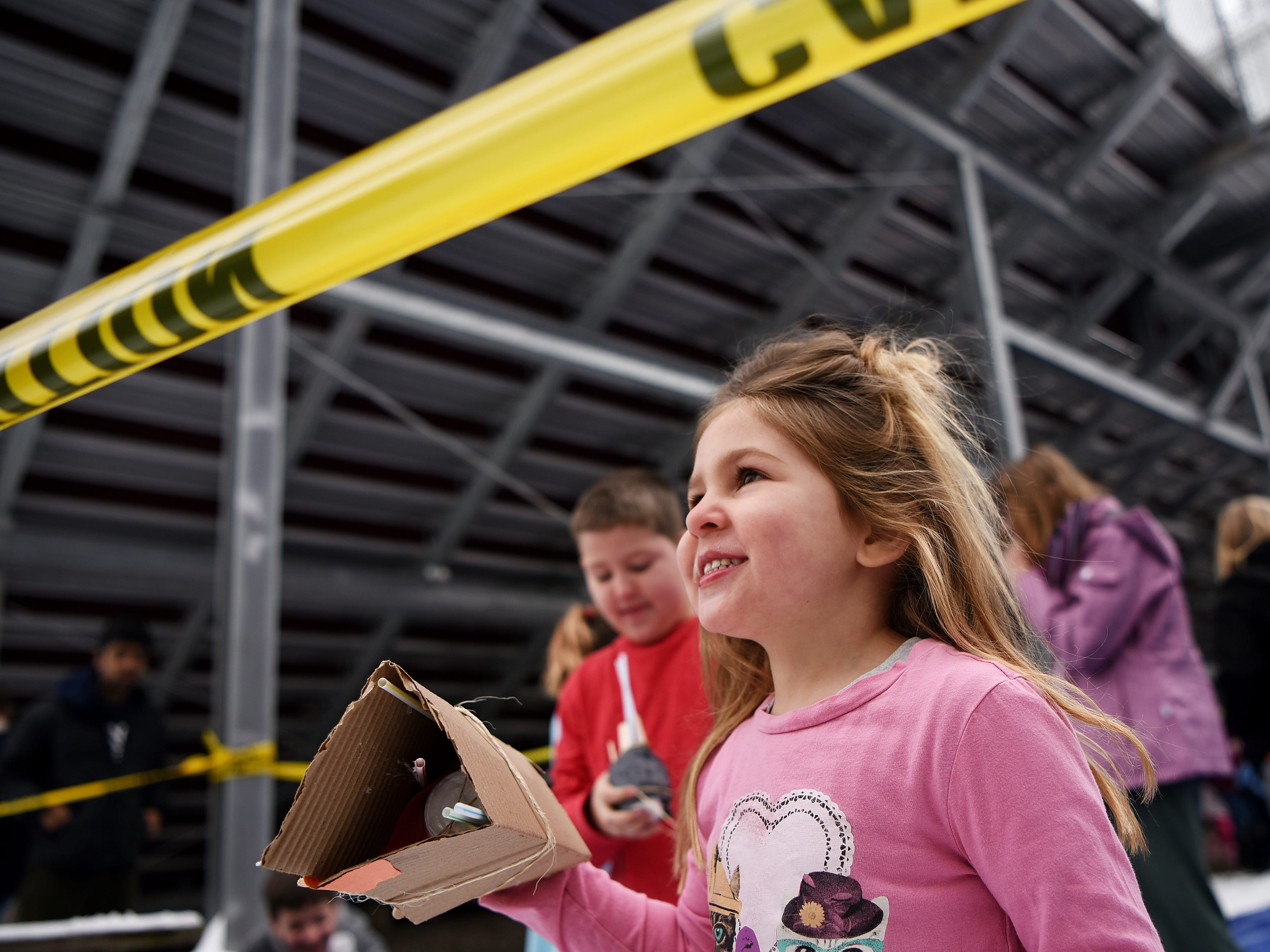 Siblings Catie, 5, and Jack, 9 check to see if their eggs landed safely during the Egg Drop. Children must create a device that will prevent their egg from breaking from a 30 foot drop. This is one of many hands on activities during Super Science Saturday held at Ridgewood High School in Ridgewood on Saturday March 2, 2019.