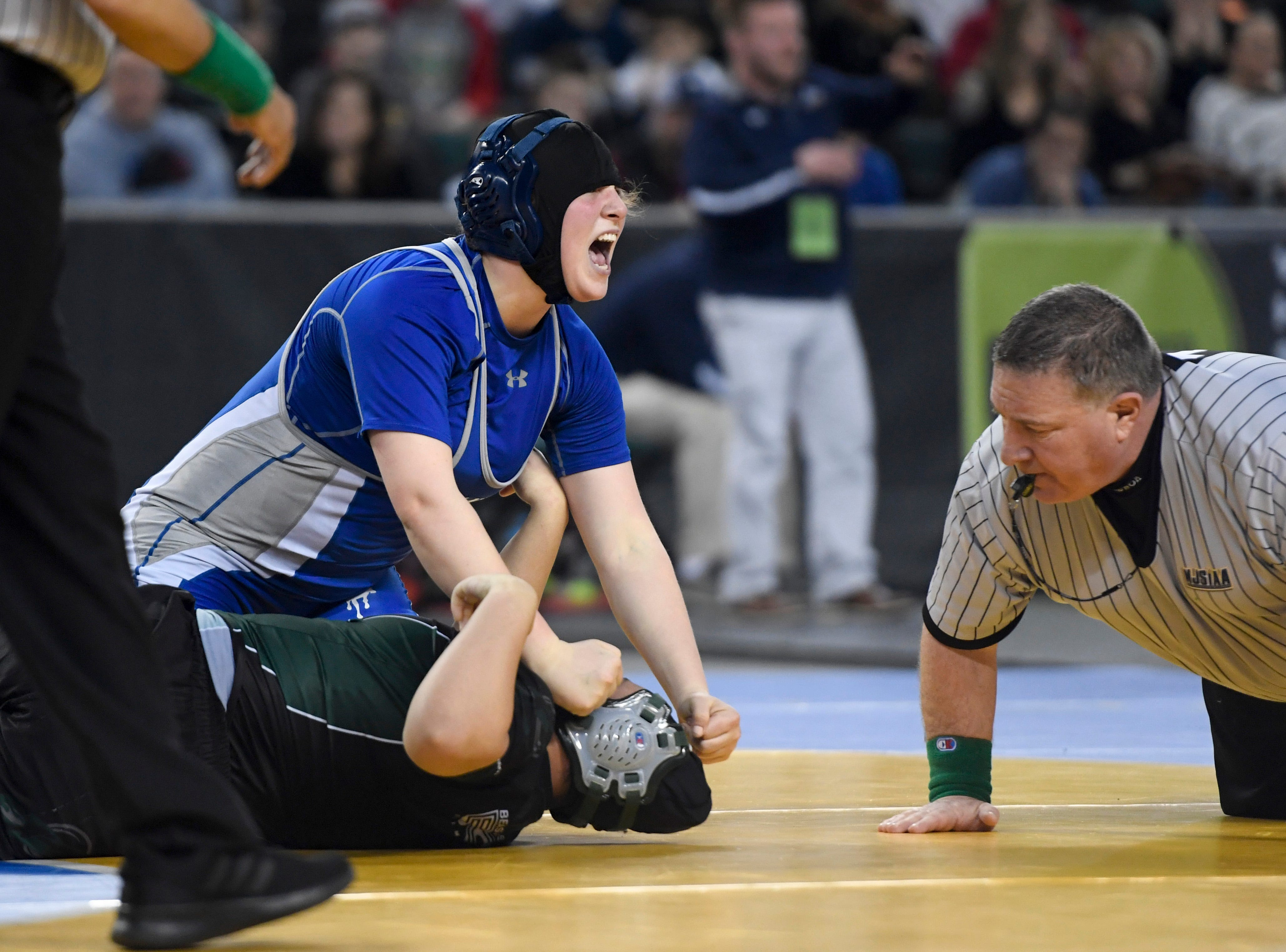 Erin Emery of Teaneck pins Mia Lazaurs of Raritan in the 185-pound final match of the NJSIAA state wrestling tournament on Saturday, March 2, 2019, in Atlantic City.
