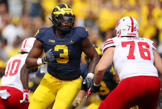 ANN ARBOR, MI - SEPTEMBER 22: Rashan Gary #3 of the Michigan Wolverines rushes the quarterback behind the block of Brenden Jaimes #76 of the Nebraska Cornhuskers on September 22, 2018 at Michigan Stadium in Ann Arbor, Michigan. Michigan won the game 56-10.