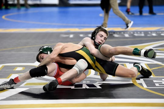 Vincent Santaniello of Brick, left, wrestles Nick Babin of Emerson/Park Ridge in the 113-pound quarterfinal on Day 2 of the NJSIAA state wrestling tournament on Friday, March 1, 2019, in Atlantic City.