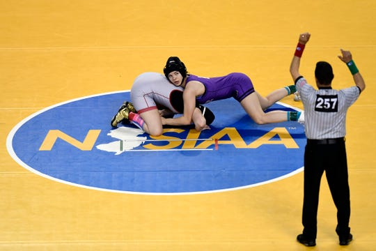 Gabby Miller of Monroe, right, wrestles Amanda Pace of North Bergen in the 147-pound final match of the NJSIAA state wrestling tournament on Saturday, March 2, 2019, in Atlantic City. Miller won by decision, 6-3.