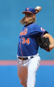 Noah Syndergaard pitches, just before the start of the game, Saturday, March 2, 2019.