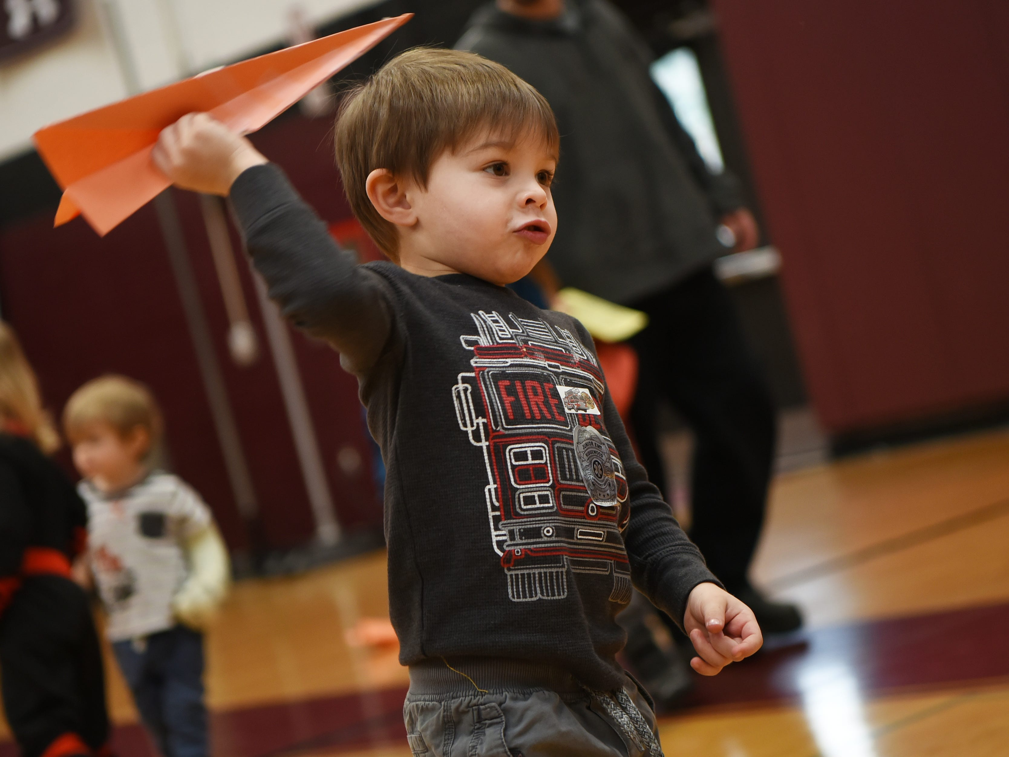 Landon Pomo, 4 gets ready to launch his paper airplane at Super Science Saturday held at Ridgewood High School in Ridgewood on Saturday March 2, 2019.