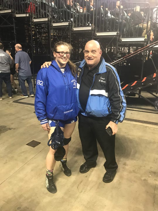 Erin Emery with Bob Willman, who won a state wrestling championship for Teaneck in 1967. Willman was Teaneck's last champion before Emery won in 2019.