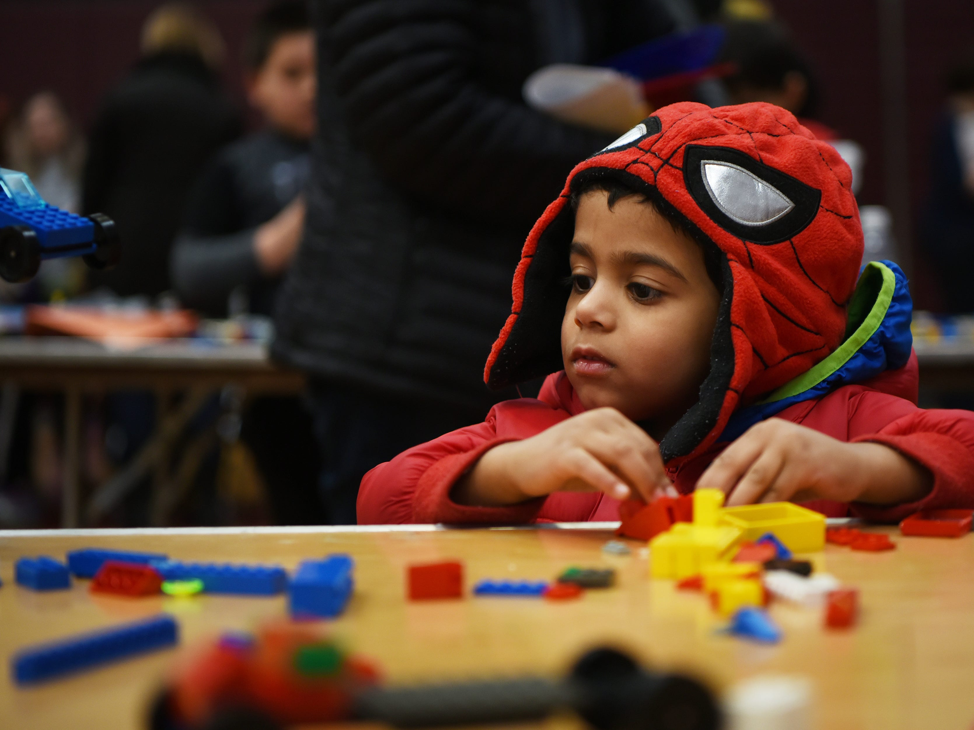 Nik Jamguli, 3, makes a LEGO creation. This is one of many activities during Super Science Saturday held at Ridgewood High School in Ridgewood on Saturday March 2, 2019.