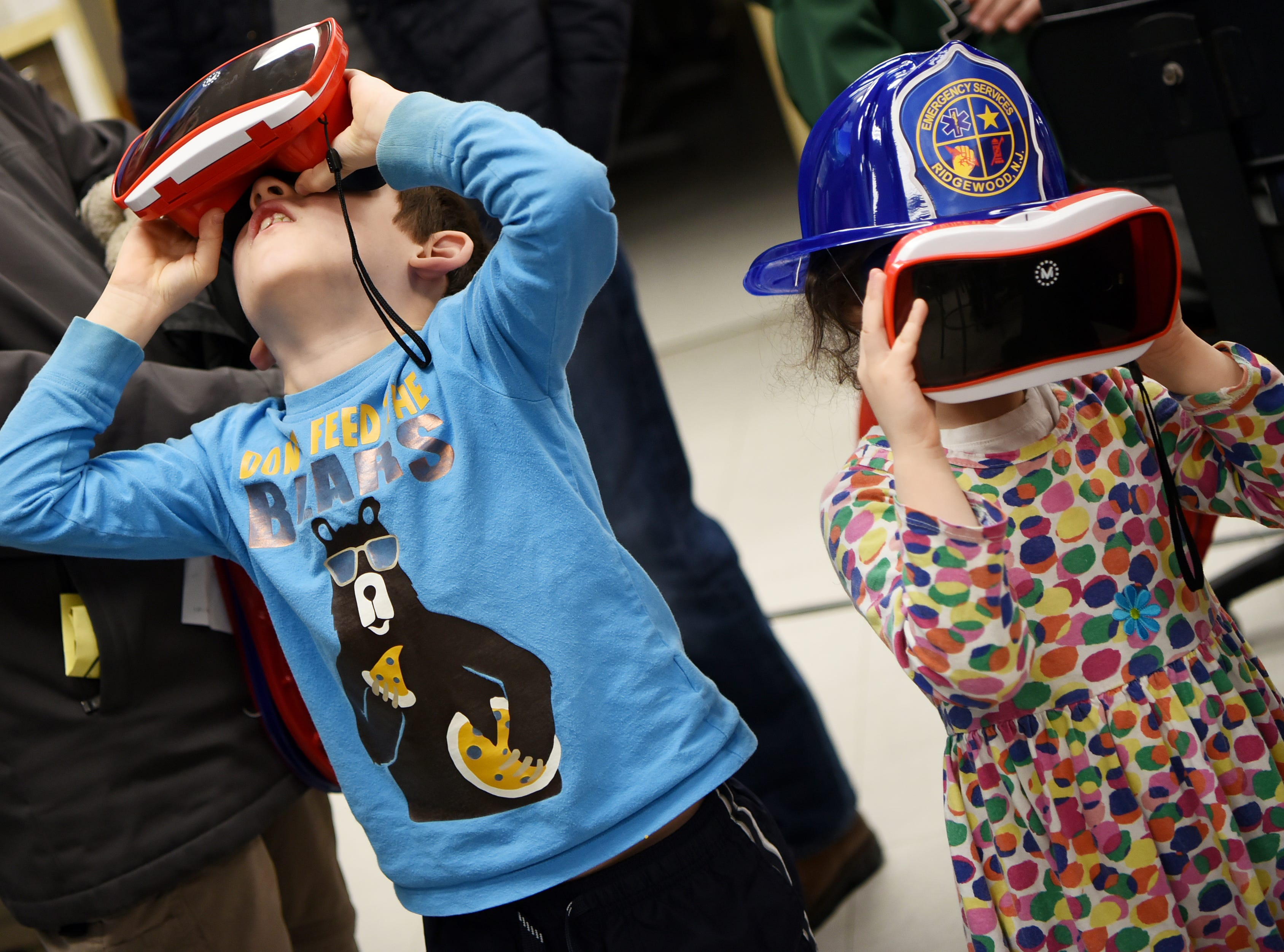 Eitan Mandelbaum, 7, and Naomi Mandlebaum, 5, wear V.R. goggles. This is one of many activities during Super Science Saturday held at Ridgewood High School in Ridgewood on Saturday March 2, 2019.