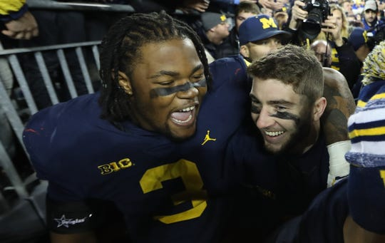 ANN ARBOR, MI - NOVEMBER 03: Rashan Gary #3 and Shea Patterson #2 of the Michigan Wolverines celebrate a win over the Penn State Nittany Lions at Michigan Stadium on November 3, 2018 in Ann Arbor, Michigan. Michigan defeated Penn State 42-7.