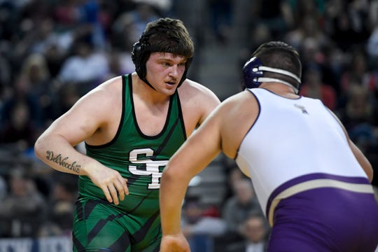 Zach DelVecchio of South Plainfield, left, faces Michael Filieri of Garfield in the 220-pound final match in the NJSIAA state wrestling tournament on Saturday, March 2, 2019, in Atlantic City.