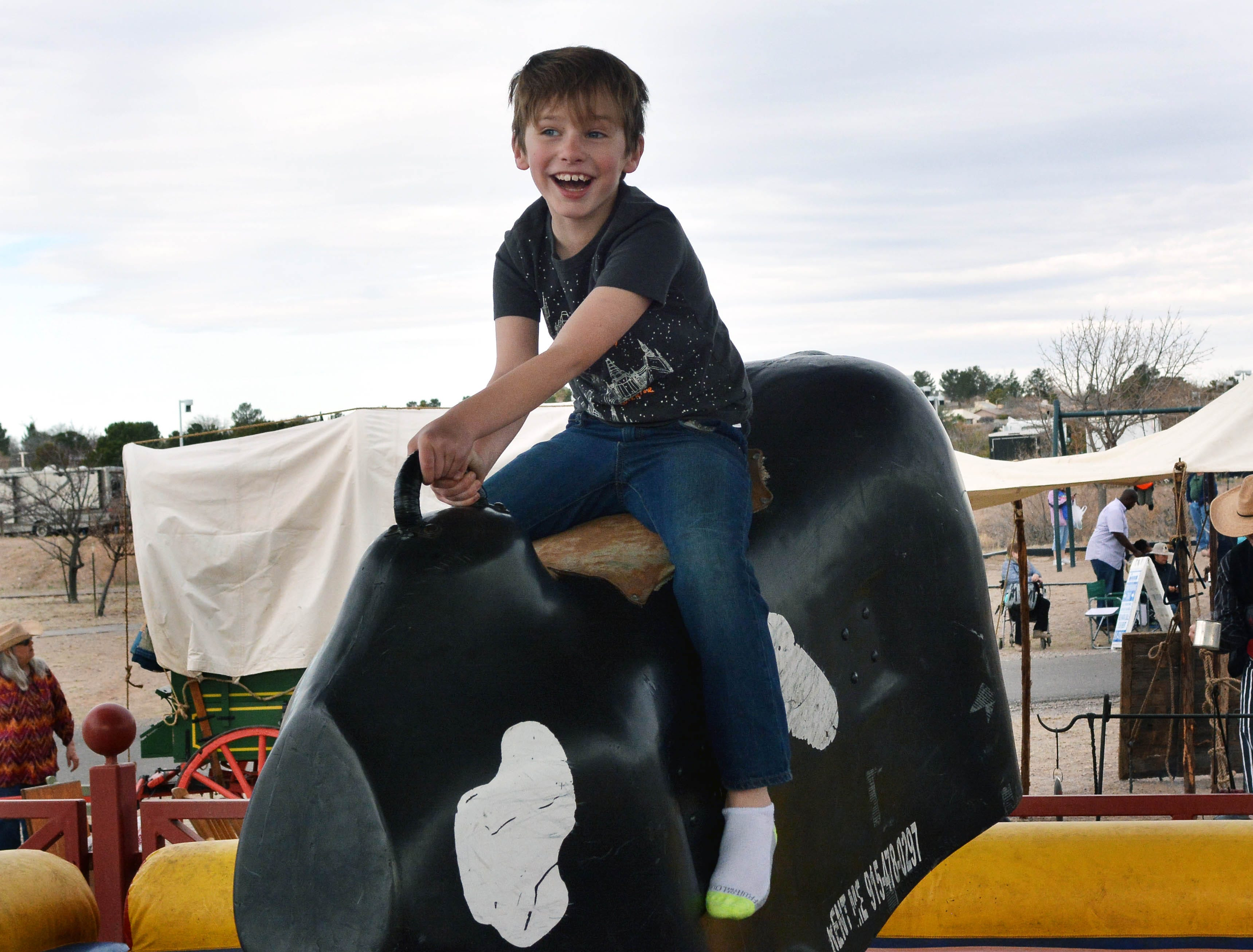 Dawson Mastriani, 8, from El Paso,enjoys his first mechanical bull ride during the 20th annual Cowboy Days held Saturday, March 2, 2019, at the New Mexico Farm and Ranch Heritage Museum.