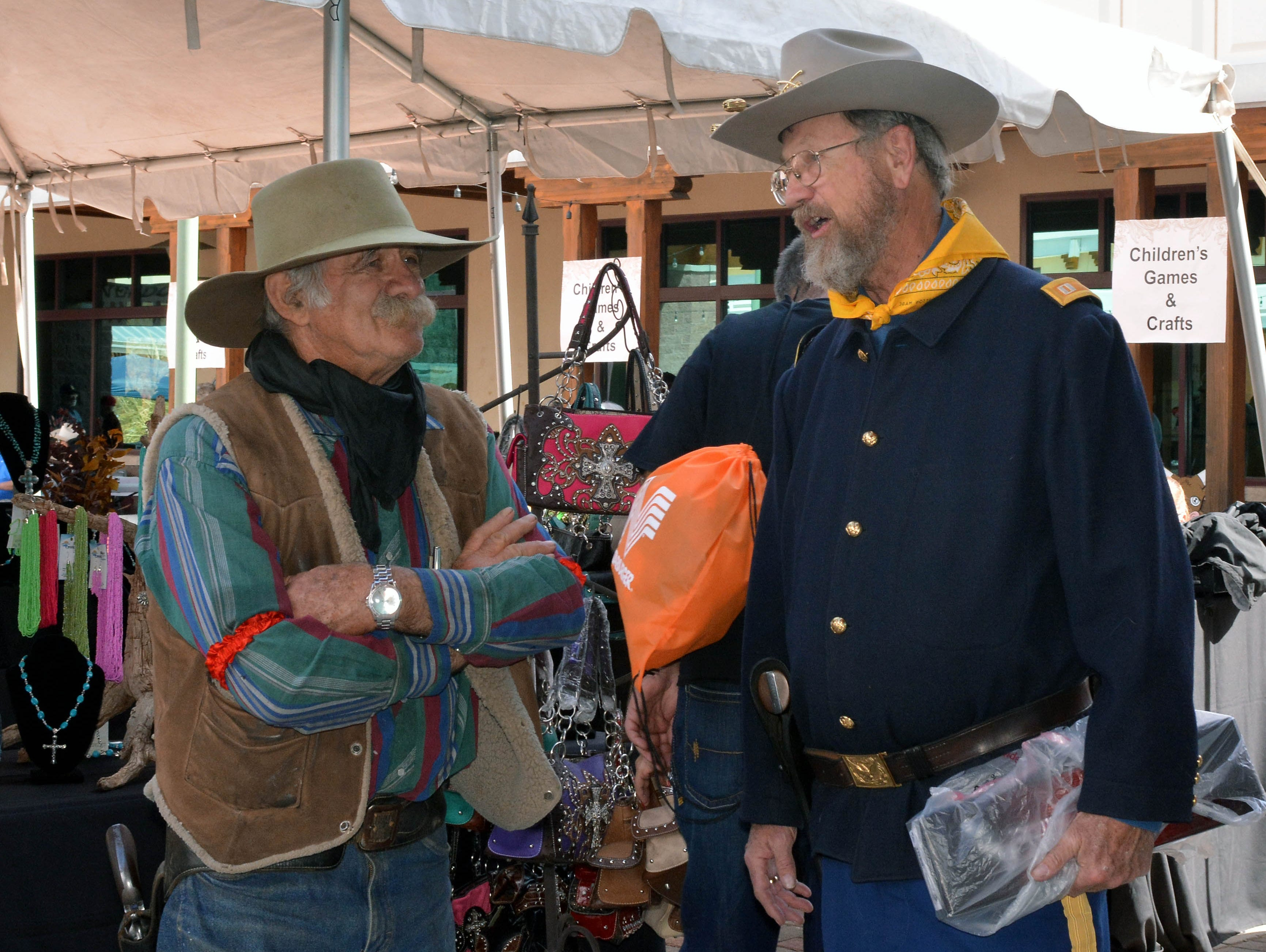 John Smith, left, of Las Cruces and Prince McKenzie, of El Paso, exchange old cowboy stories at the 20th annual Cowboy Days held Saturday, March 2, 2019, at the New Mexico Farm and Ranch Heritage Museum.