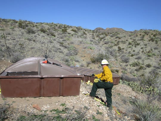 A BLM wildlife biologist helps set a guzzler delivered to Still Ridge in the Peloncillo Mountains west of Lordsburg. The guzzler will capture rainwater and provides a water source for area wildlife.