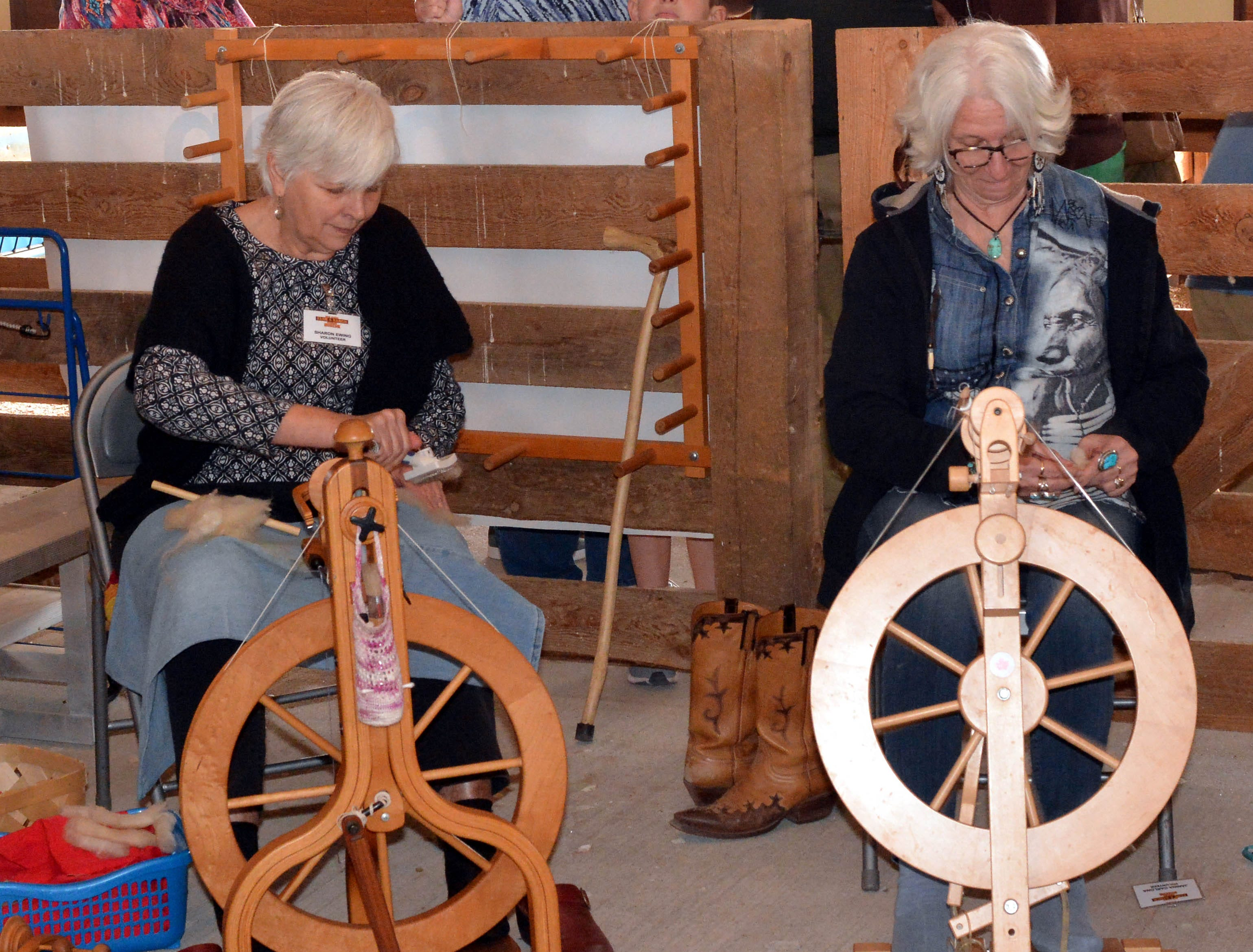 Sharon Ewing, left, and Janina Tarlona spin wool into yarn at the 20th annual Cowboy Days held Saturday, March 2, 2019, at the New Mexico Farm and Ranch Heritage Museum.