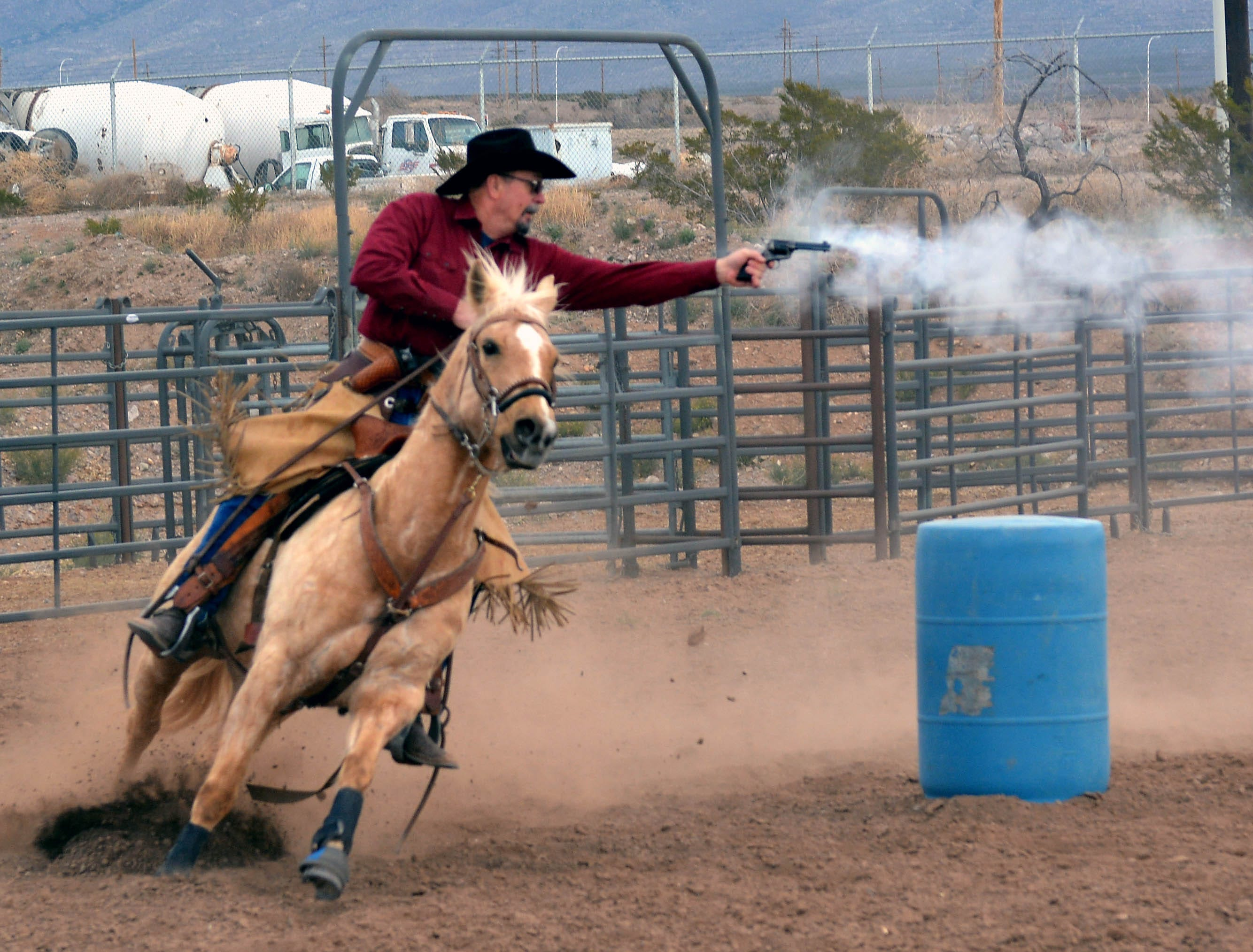 Billy Horner from Artesia does some trick shooting on his horse during the 20th annual Cowboy Days held Saturday, March 2, 2019, at the New Mexico Farm and Ranch Heritage Museum.