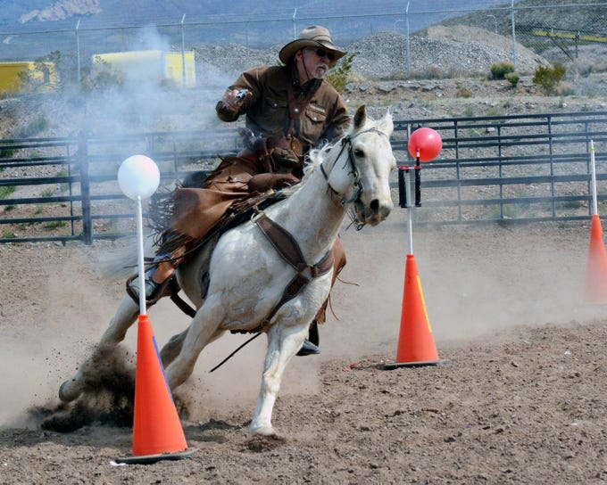 Robert Barnard of Las Cruces shows off his skills during a shooting exhibition at the 20th annual Cowboy Days, held Saturday, March 2, 2019, at the New Mexico Farm and Ranch Heritage Museum.