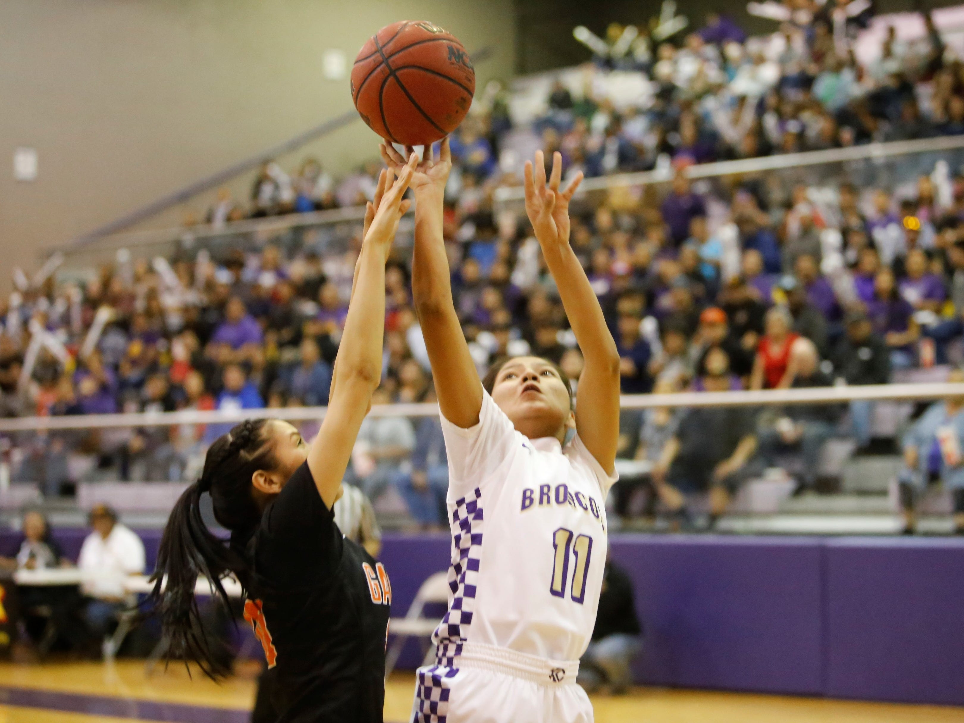 Kirtland Central's Melanie Yazzie makes a basket against Gallup during Friday's District 1-4A tournament championship game at Bronco Arena.