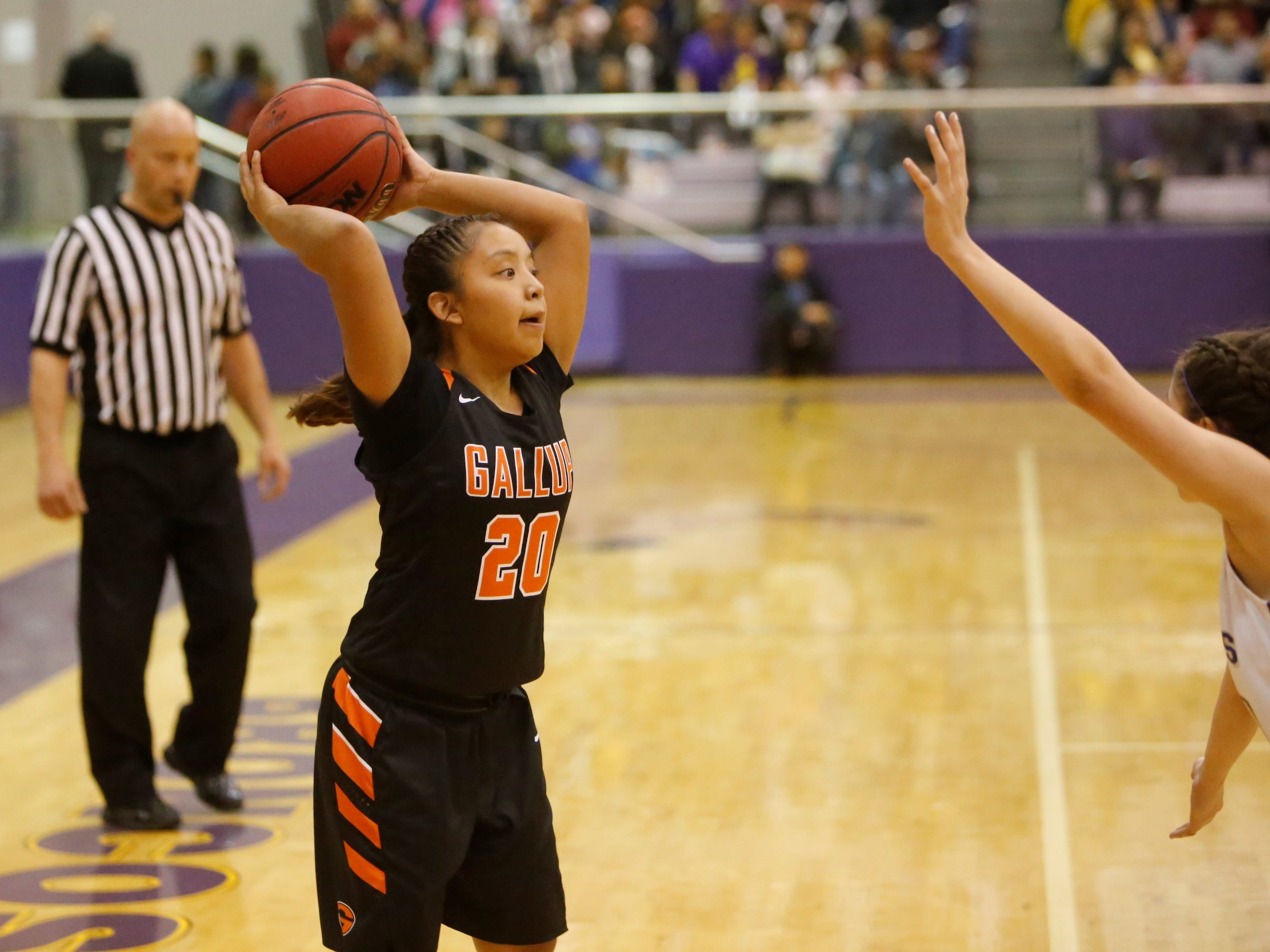 Gallup's Kamryn Yazzie looks to pass the ball into the paint against Kirtland Central during Friday's District 1-4A tournament championship game at Bronco Arena.