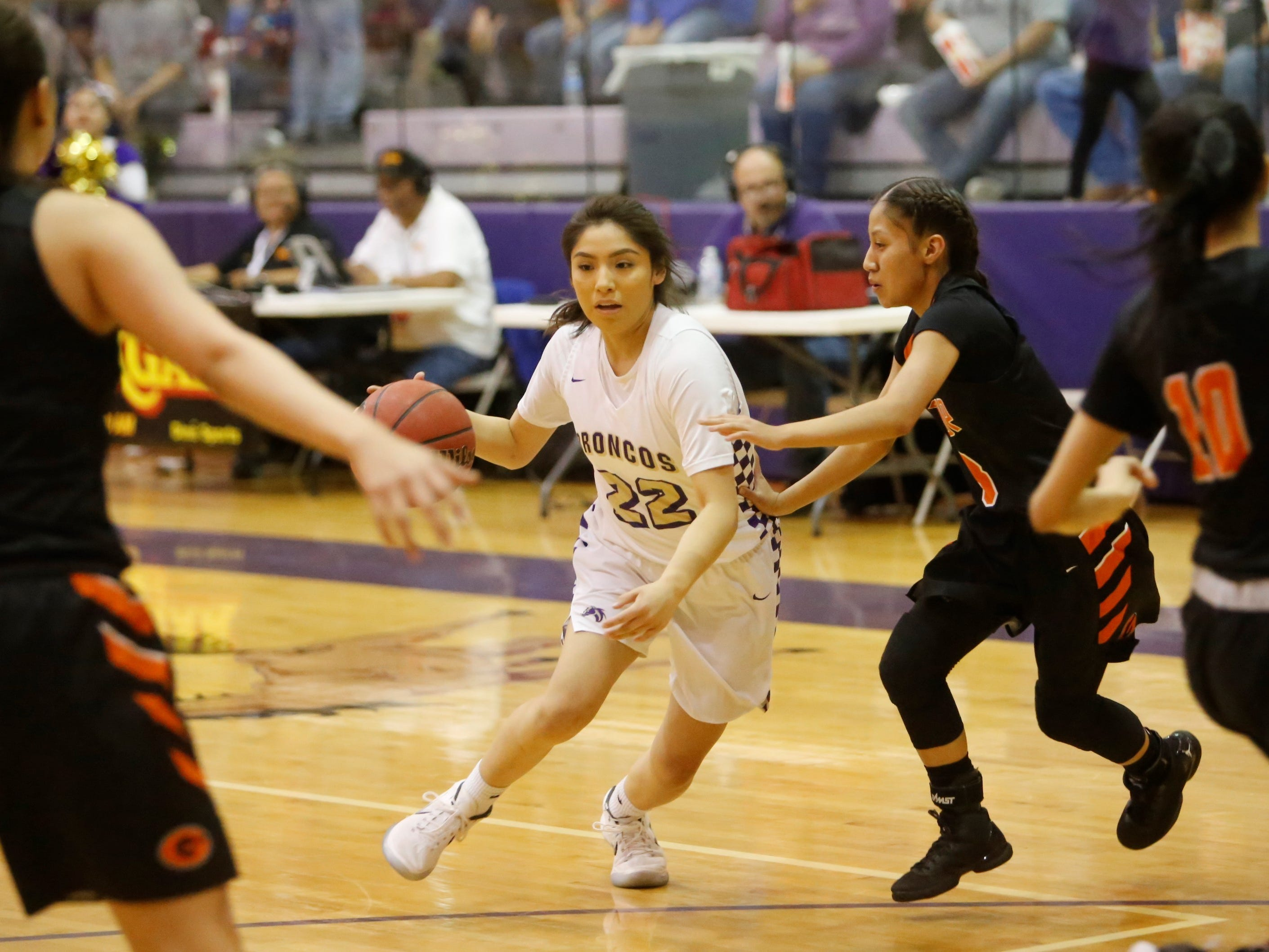 Kirtland Central's Tatelyn Manheimer drives toward the basket against Gallup during Friday's District 1-4A tournament championship game at Bronco Arena.