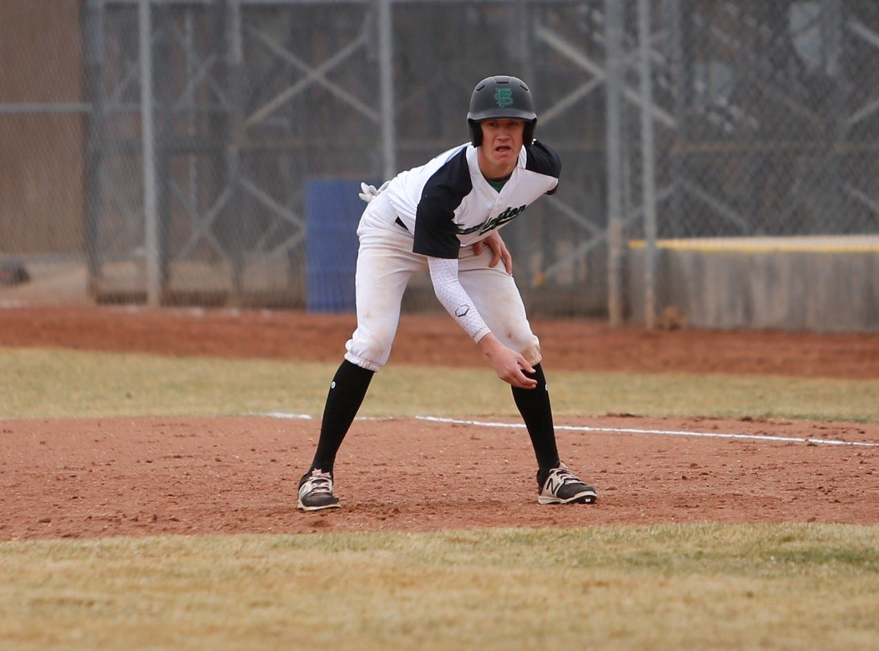 Farmington's Isaiah Royce waits for his chance to bolt to second base against Miyamura during Saturday's game at Ricketts Park in Farmington.