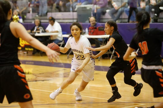 Kirtland Central's Tatelyn Manheimer drives toward the basket against Gallup during Friday's District 1-4A tournament championship game at Bronco Arena. Visit daily-times.com tonight to find out who made this year's state basketball playoffs.