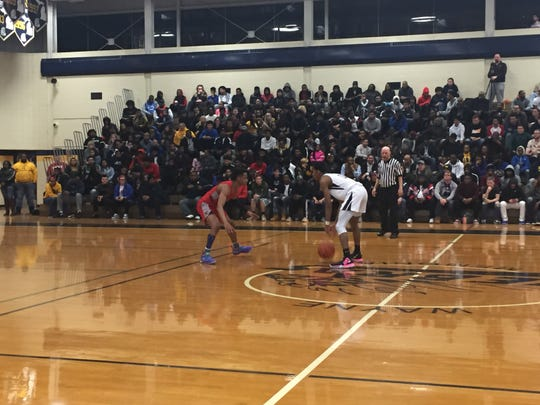 Wayne Memorial's Isaiah Lewis is guarded by Canton's B. Artis White in Friday night's district final.