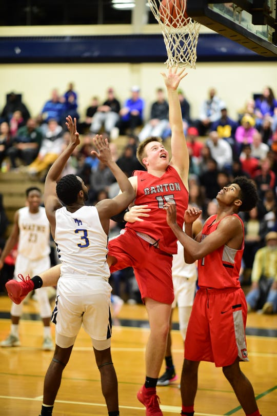 Canton's Jake Vickers (15) goes up for a shot.