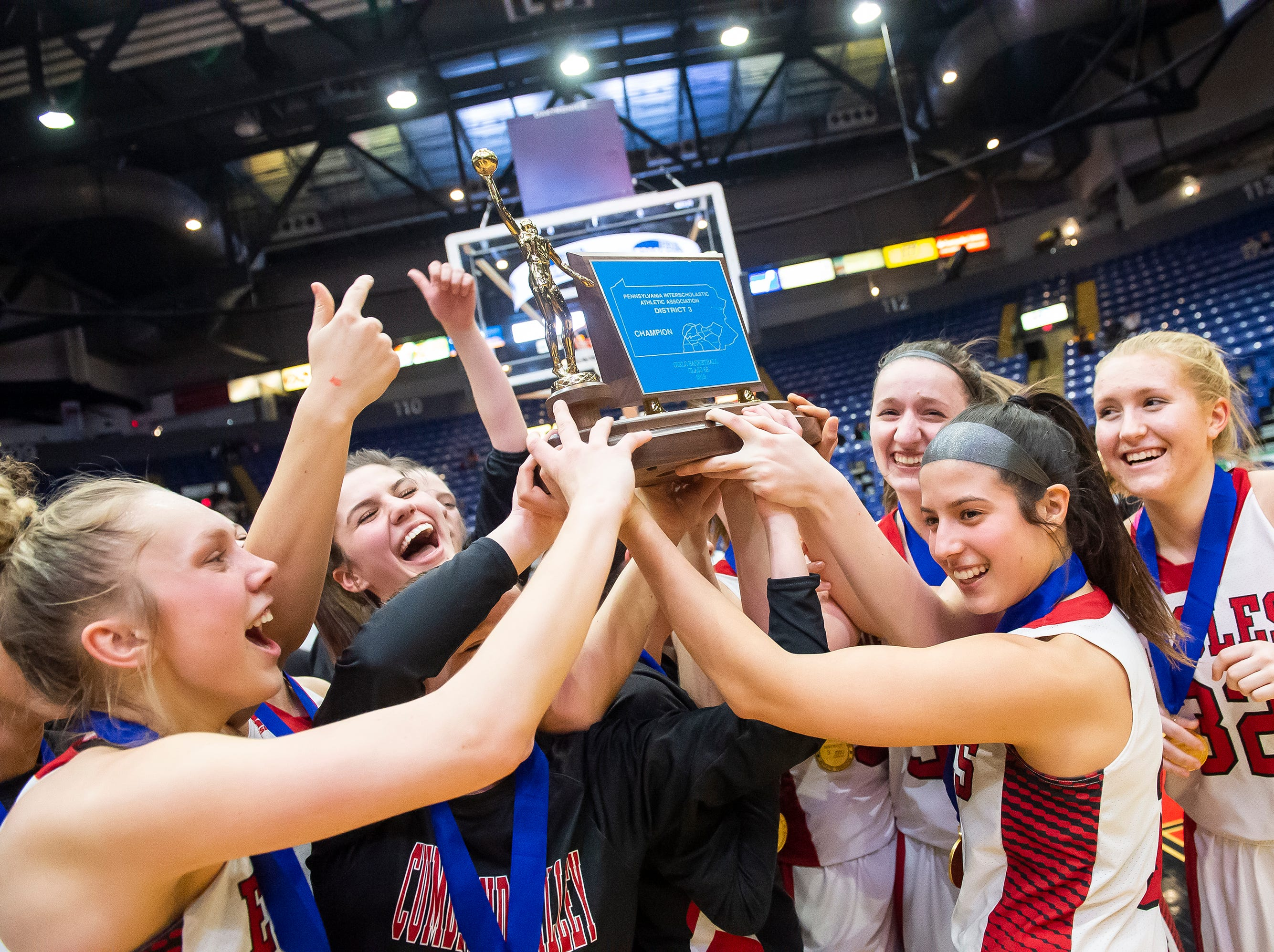The Cumberland Valley Eagles celebrate with their trophy after defeating Dallastown in the District 3 6A girls championship game at Santander Arena in Reading, Pa., Friday, March 1, 2019. The Eagles won 33-27.