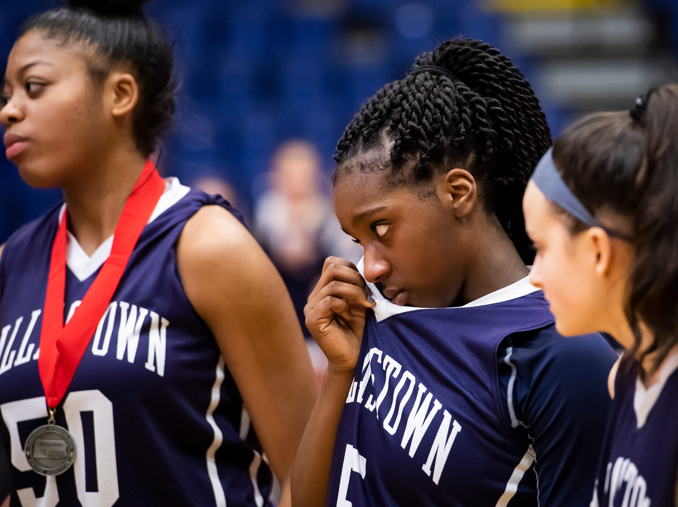 Dallastown's D'Shantae Edwards wipes her eye after the Wildcats fell in the District 3 6A girls championship game against Cumberland Valley at the Santander Arena in Reading, Pa., Friday, March 1, 2019. Dallastown fell 33-27.