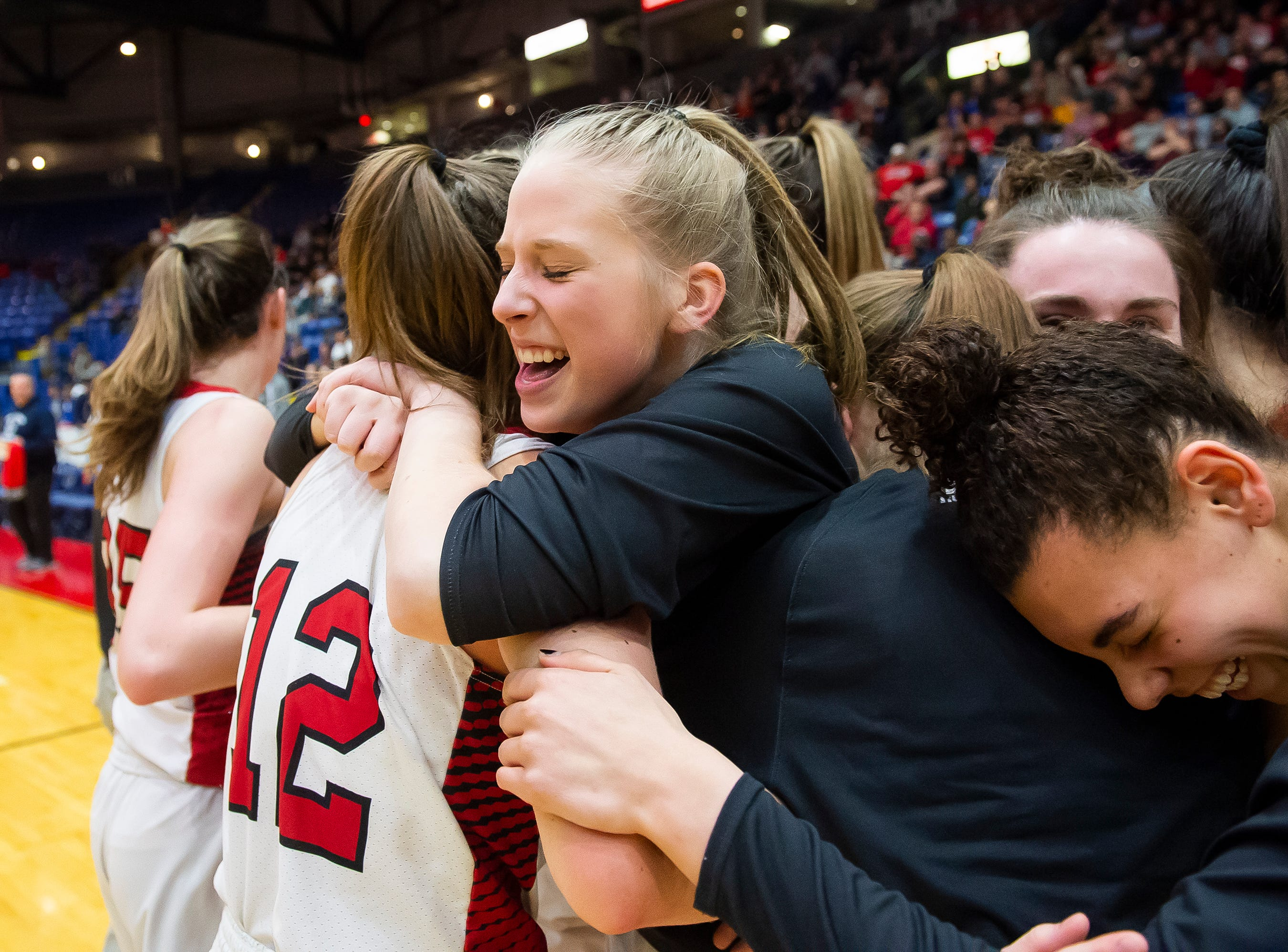 The Cumberland Valley Eagles celebrate after defeating Dallastown in the District 3 6A girls championship game at Santander Arena in Reading, Pa., Friday, March 1, 2019. The Eagles won 33-27.