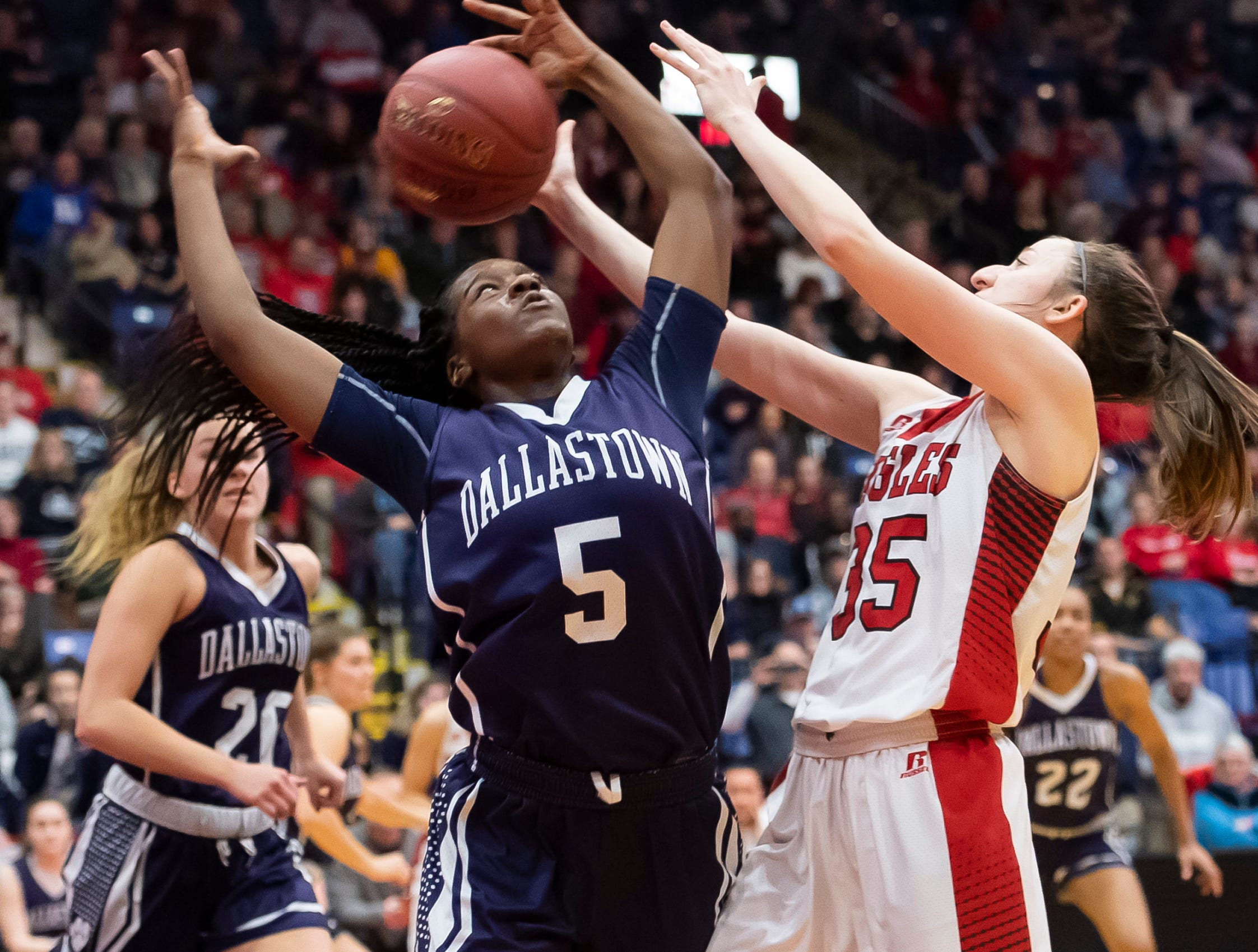 Dallastown's D'Shantae Edward (5) and Cumberland Valley's Kennedy Kuffa vie for a rebound during the District 3 6A girls championship game at the Santander Arena in Reading, Pa., Friday, March 1, 2019. Dallastown fell 33-27.