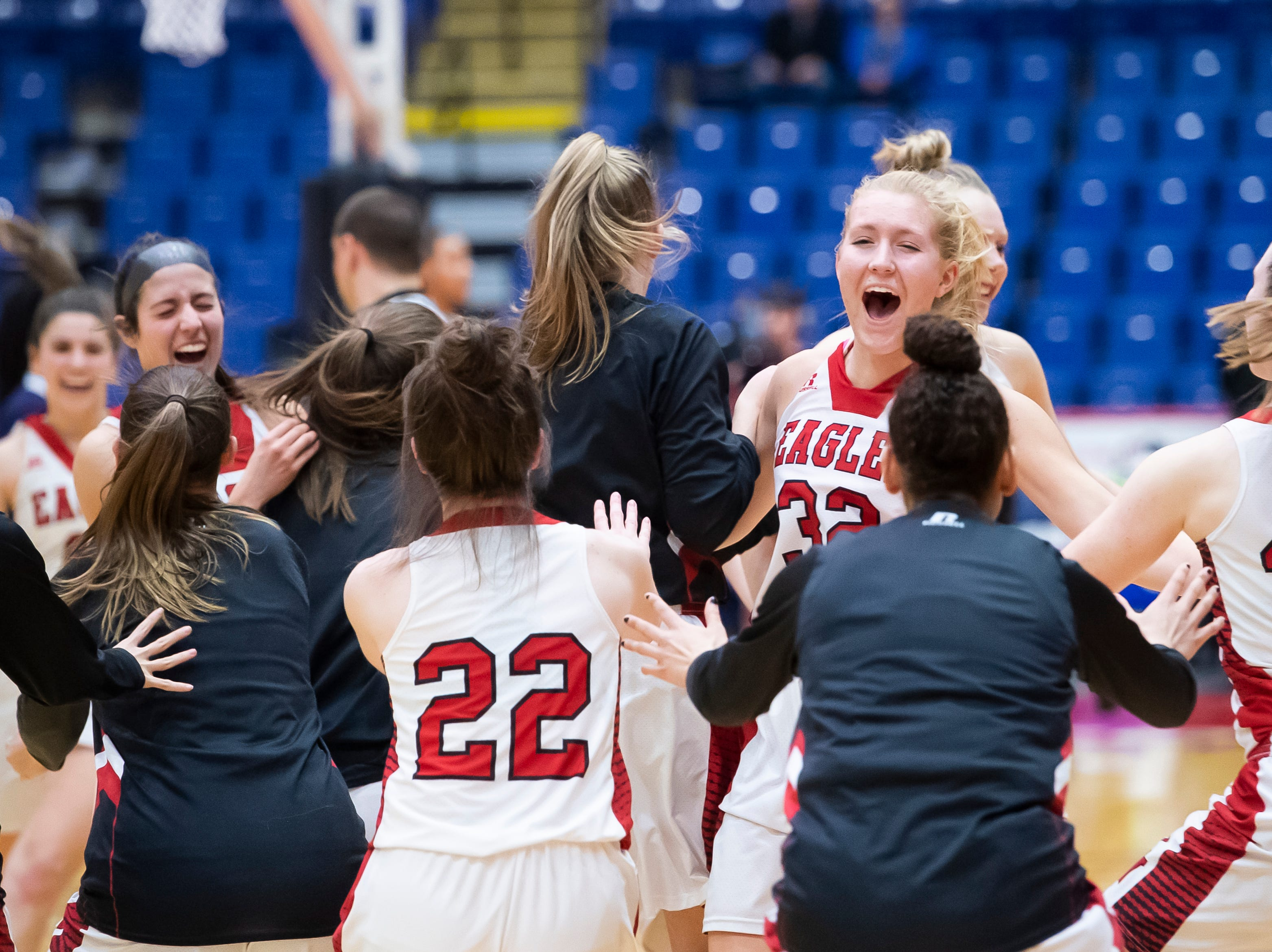 The Cumberland Valley Eagles celebrate on the court after defeating Dallastown in the District 3 6A girls championship game at Santander Arena in Reading, Pa., Friday, March 1, 2019. The Eagles won 33-27.