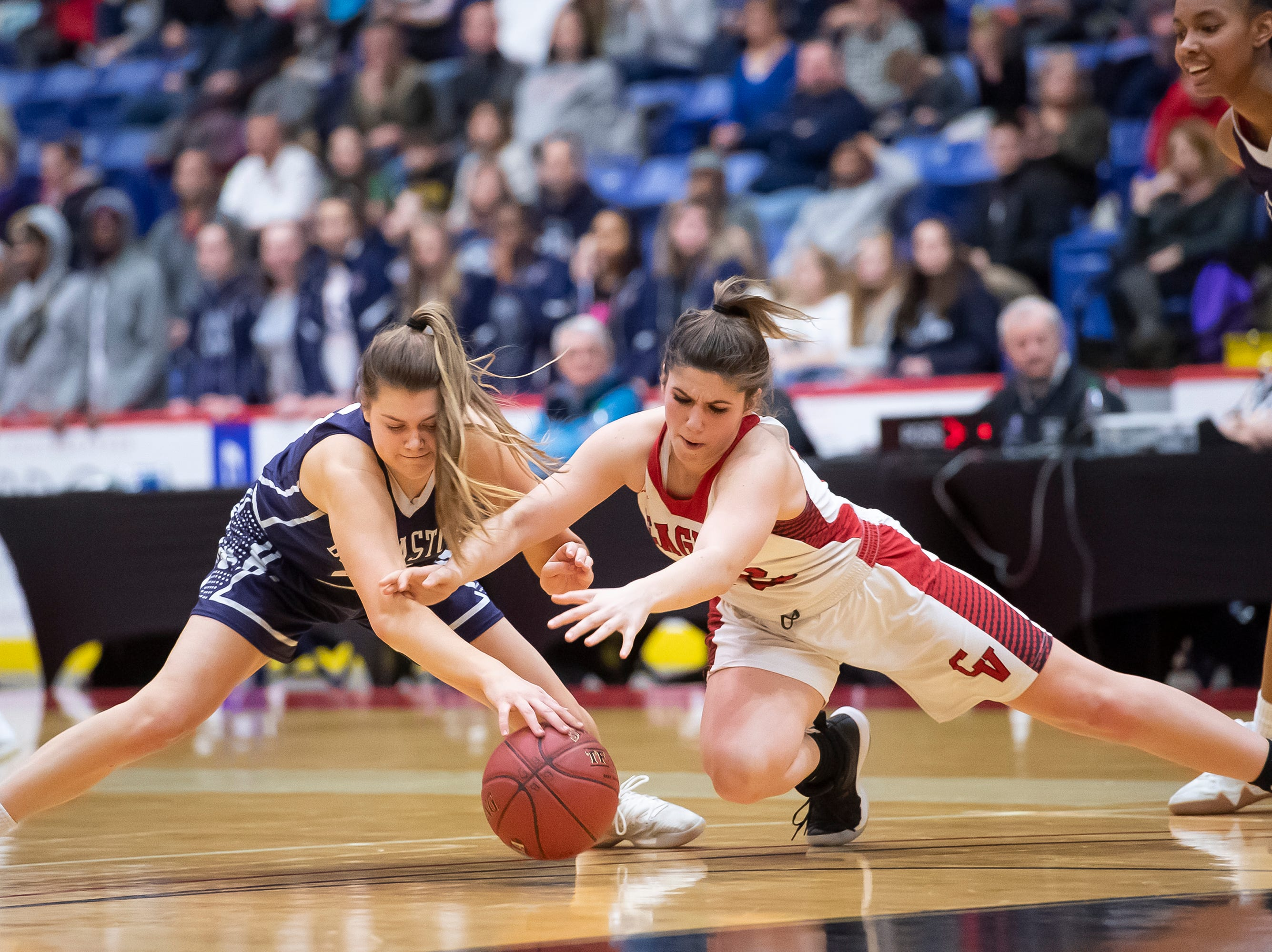 Dallastown's Madi Moore, left and Cumberland Valley's Abbie Miller reach for a loose ball during the District 3 6A girls championship game at the Santander Arena in Reading, Pa., Friday, March 1, 2019. Dallastown fell 33-27.