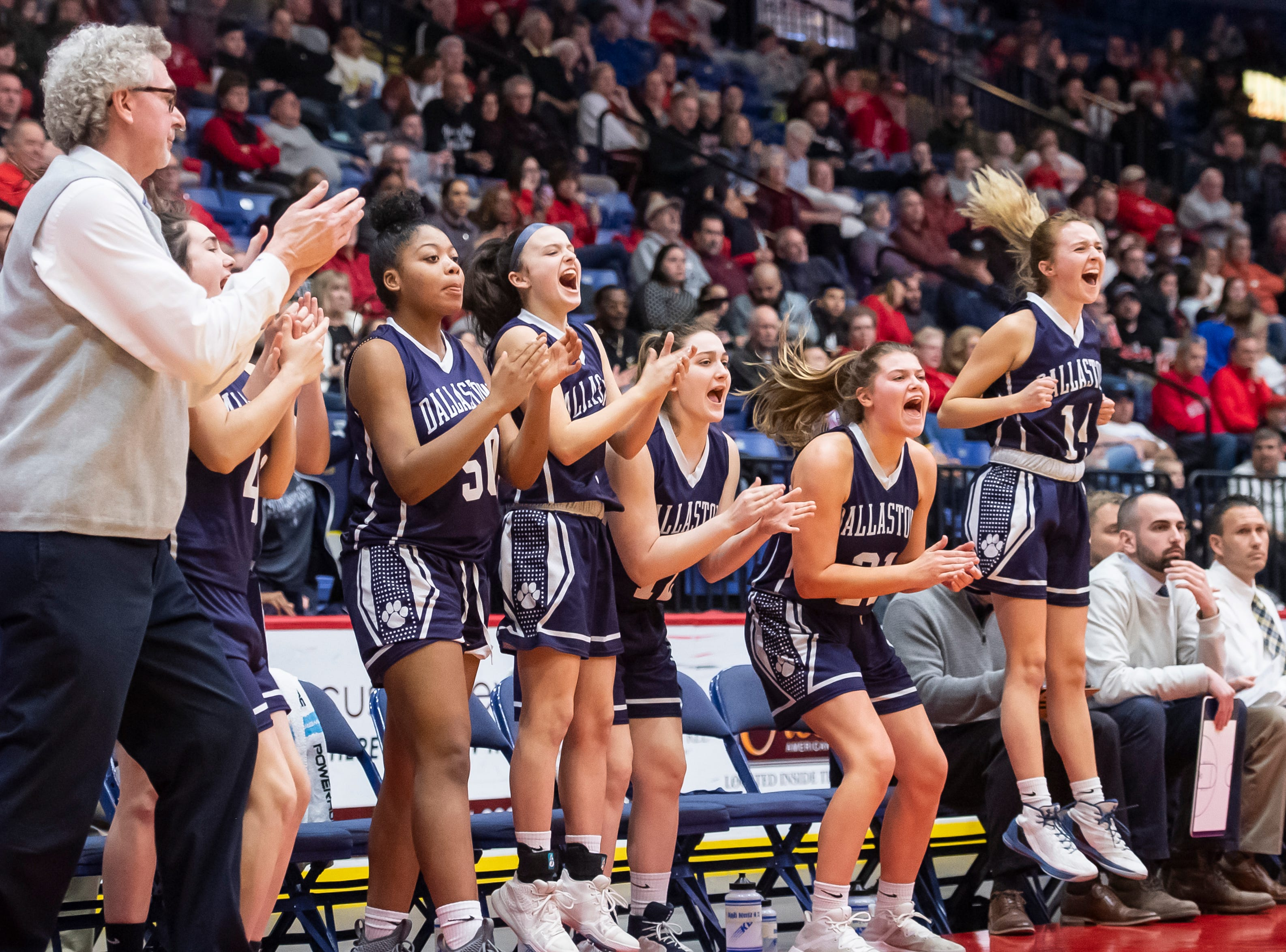 The Dallastown bench reacts after the Wildcats score during the District 3 6A girls championship game against Cumberland Valley at the Santander Arena in Reading, Pa., Friday, March 1, 2019. Dallastown fell 33-27.