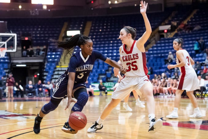 Dallastown's D'Shantae Edwards drives against Cumberland Valley's Kennedy Kuffa during the District 3 6A girls championship game at the Santander Arena in Reading, Pa., Friday, March 1, 2019. Dallastown fell 33-27.