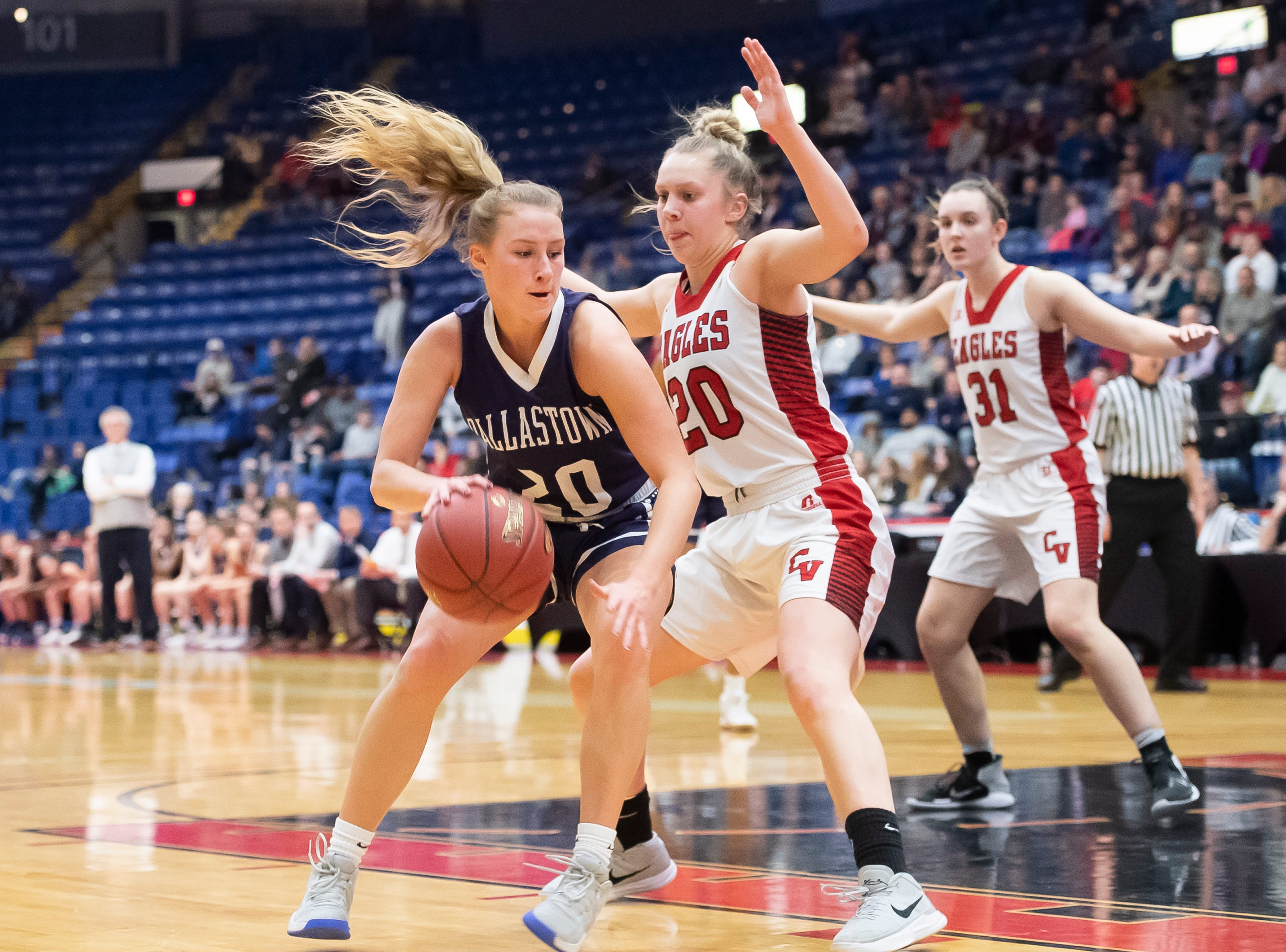 Dallastown's Lily Jamison drives against Cumberland Valley's Julie Jekot during the District 3 6A girls championship game at the Santander Arena in Reading, Pa., Friday, March 1, 2019. Dallastown fell 33-27.