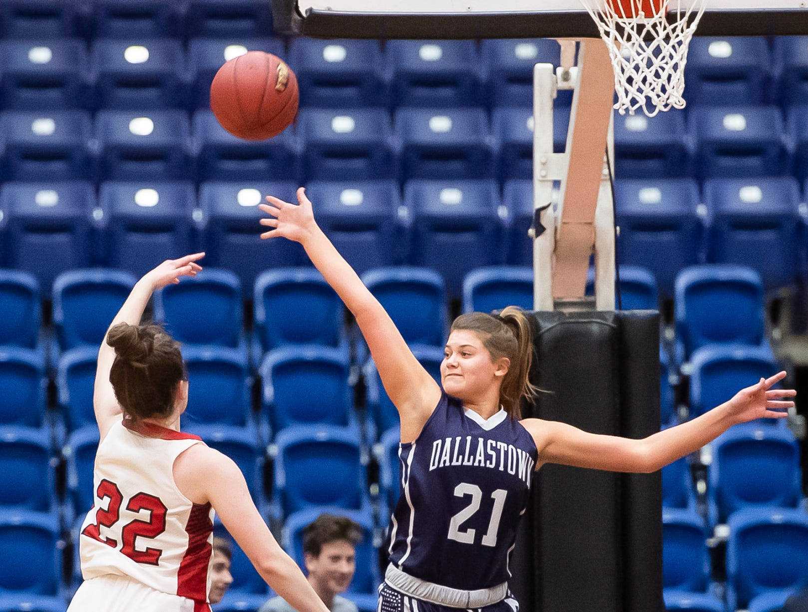 Cumberland Valley's Kylie Holcomb shoots over Dallastown's Madi Moore in the District 3 6A girls championship game at Santander Arena in Reading, Pa., Friday, March 1, 2019. The Eagles won 33-27.