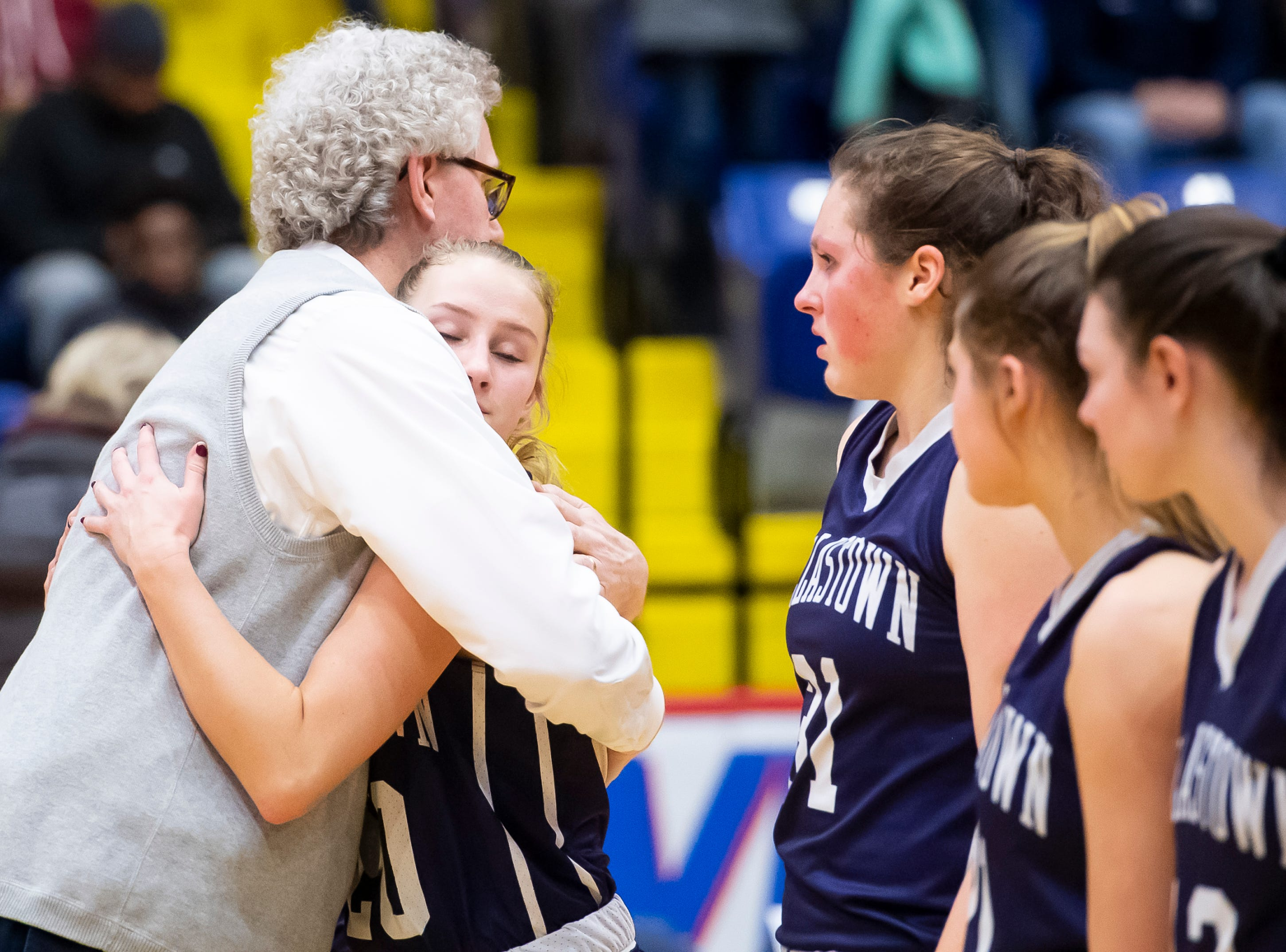 Dallastown head coach Jay Rexroth hugs Lily Jamison after the Wildcats fell in the District 3 6A girls championship game against Cumberland Valley at the Santander Arena in Reading, Pa., Friday, March 1, 2019. Dallastown fell 33-27.