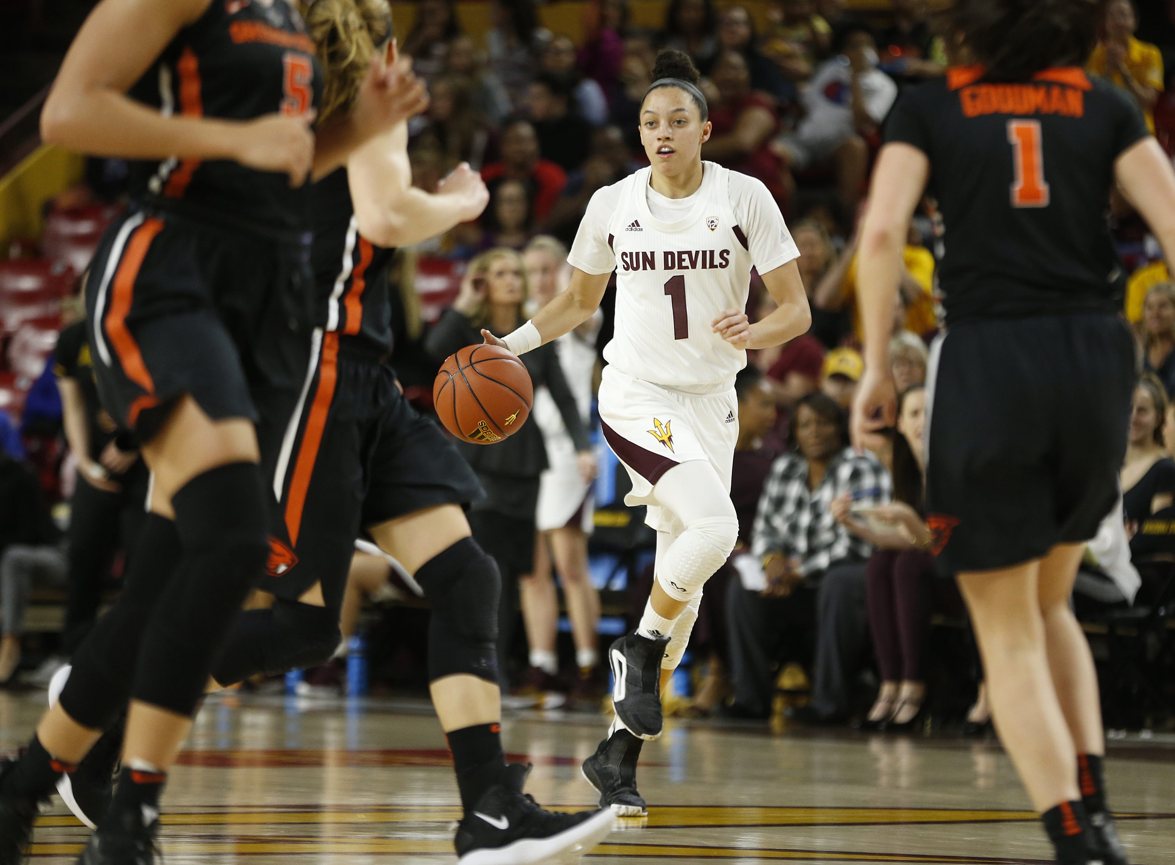 ASU's Reili Richardson (1) dribbles up the court against Oregon State's Aleah Goodman (1) during the first half at Wells Fargo Arena in Tempe, Ariz. on March 1, 2019.